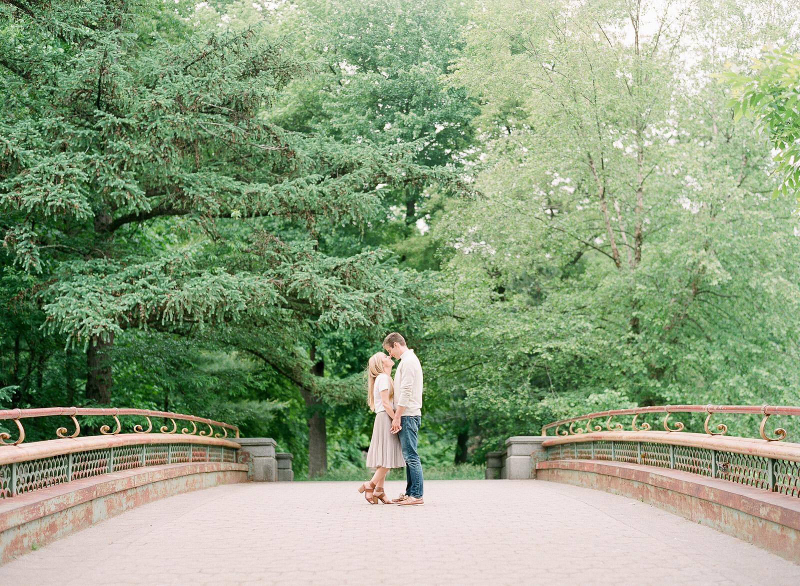couple on bridge engagement photo