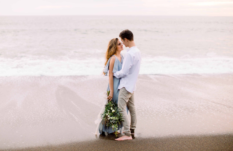 couple embrace on beach engagement photo