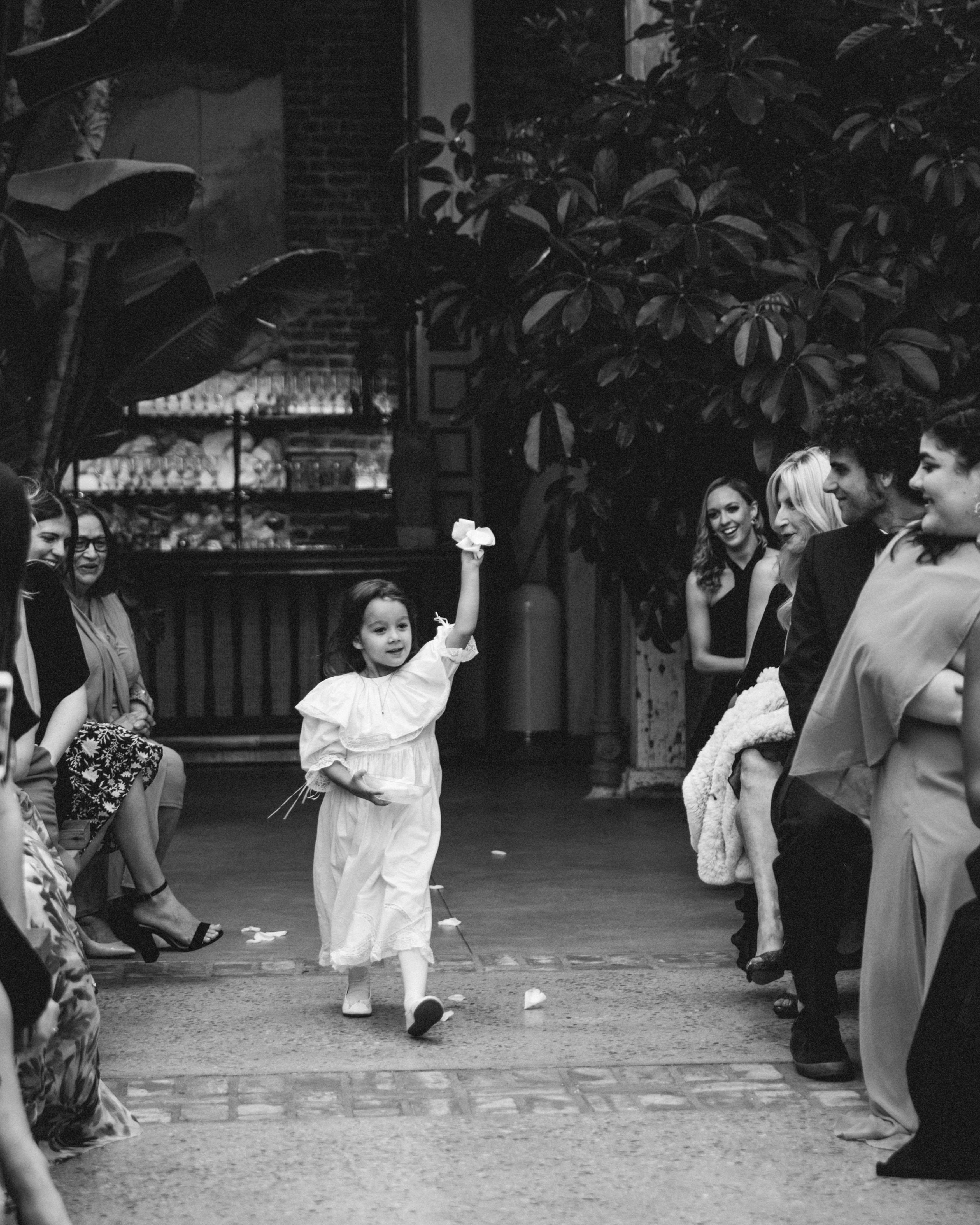 wedding flowergirl walking down aisle black and white