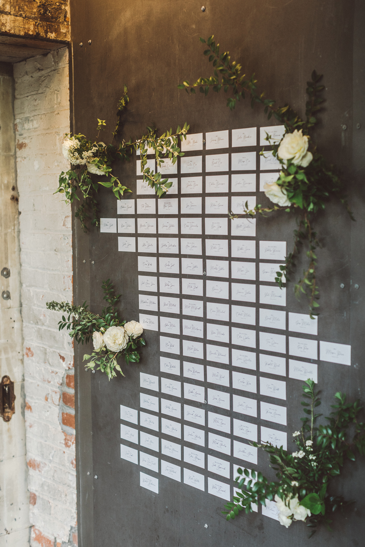 kaily matt wedding los angeles escort cards surrounded by white flowers