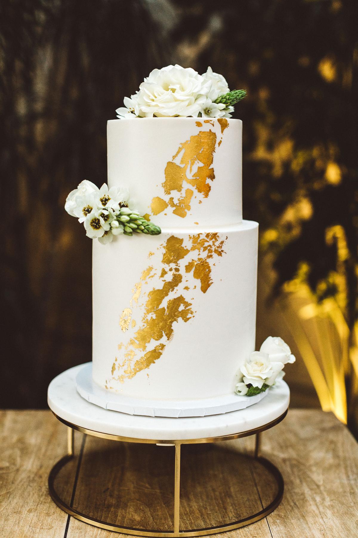 kaily matt wedding los angeles gold wedding cake with white flowers