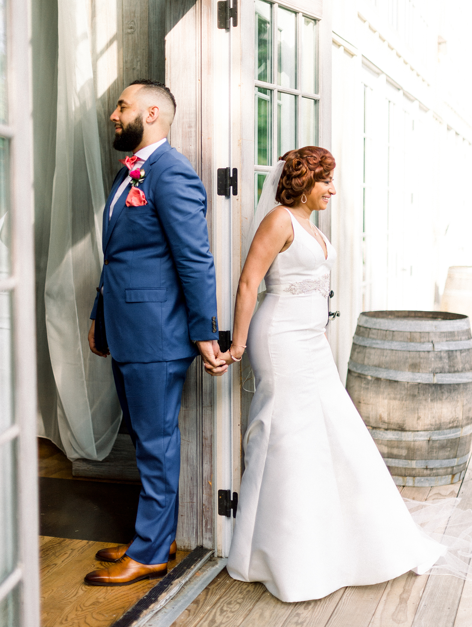 dawn rich wedding first look holding hands with wall in between
