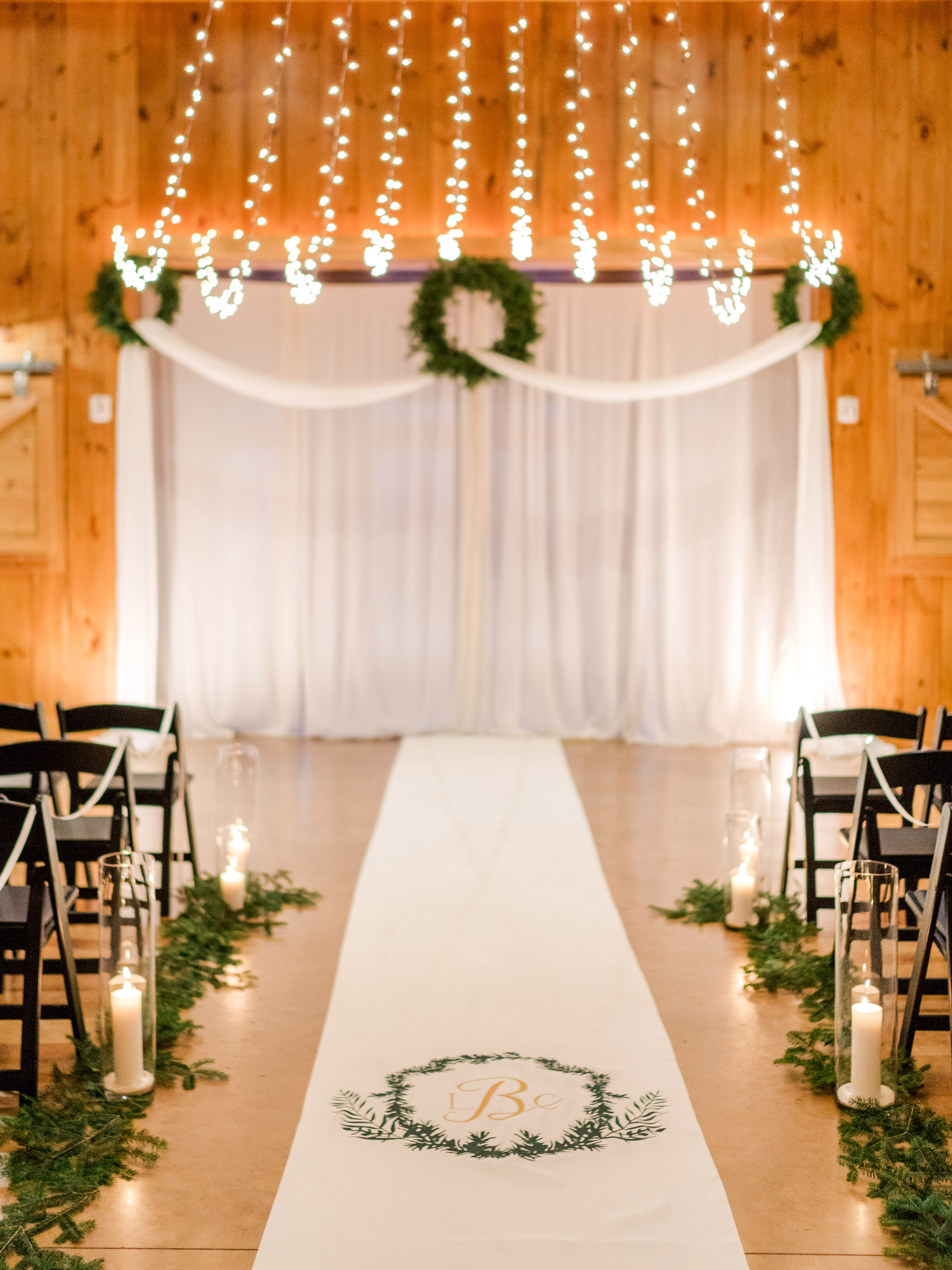 lauren christian christmas wedding ceremony aisle monogrammed runner lights