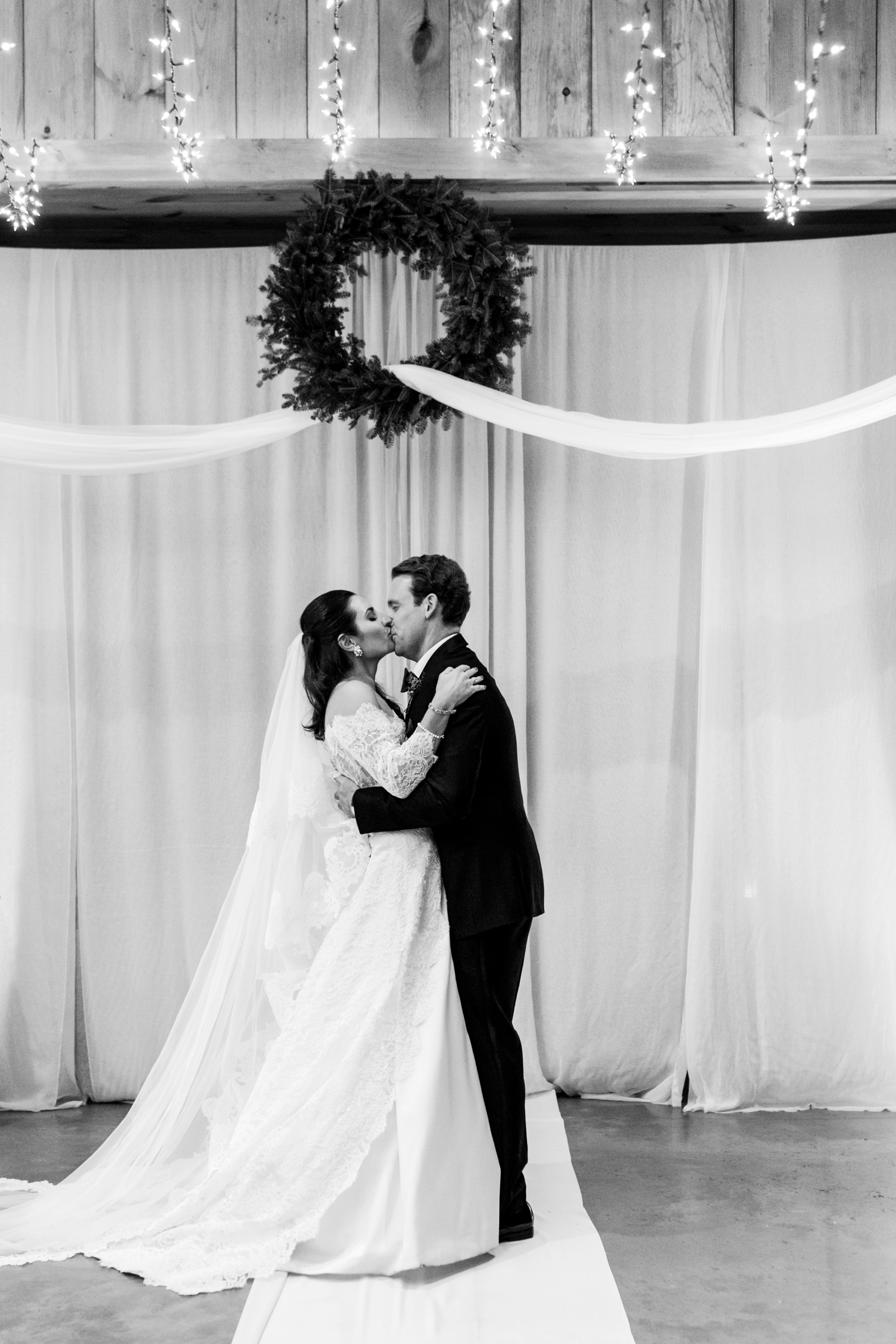 lauren christian christmas wedding ceremony couple kiss
