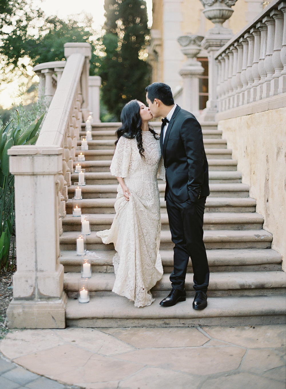 emme daji wedding couple kissing on staircase