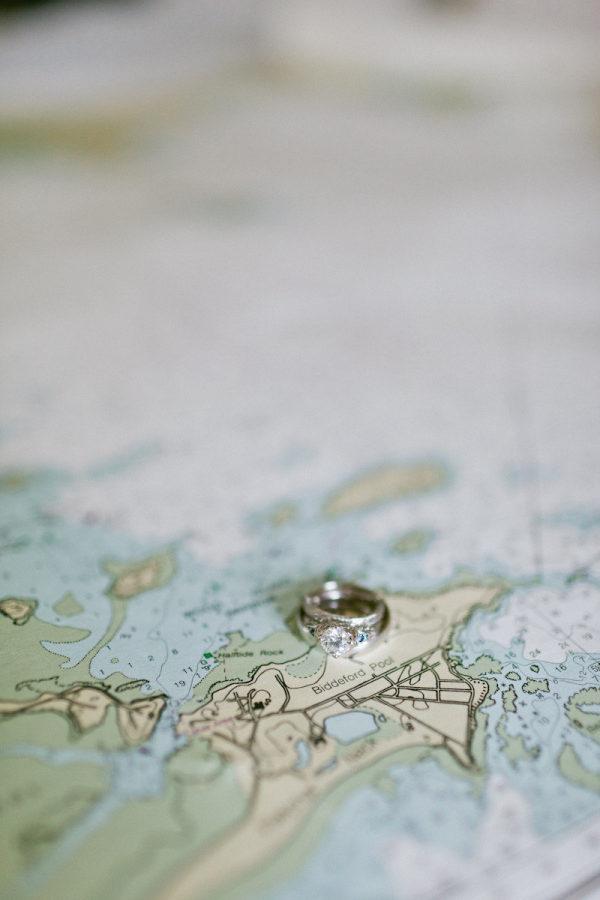 wedding ring sitting on map