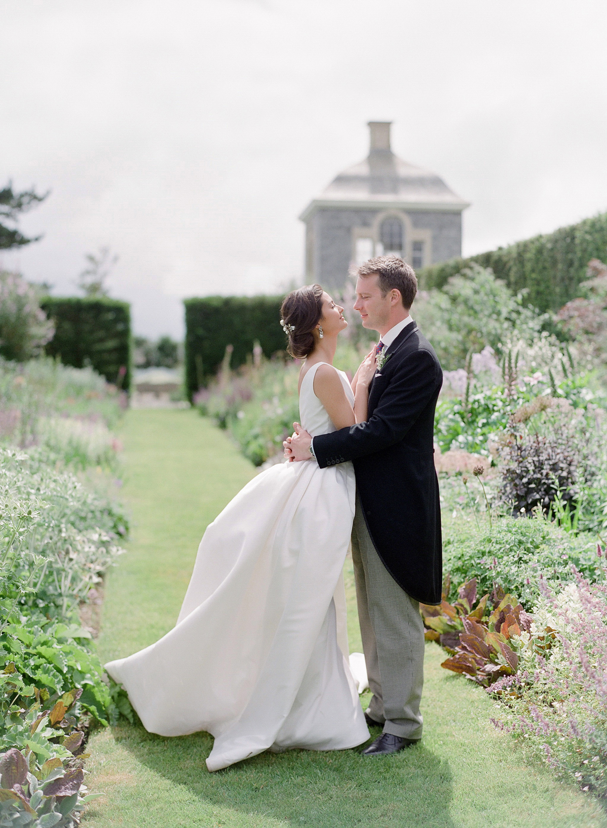 peony matthew england wedding couple embracing in garden