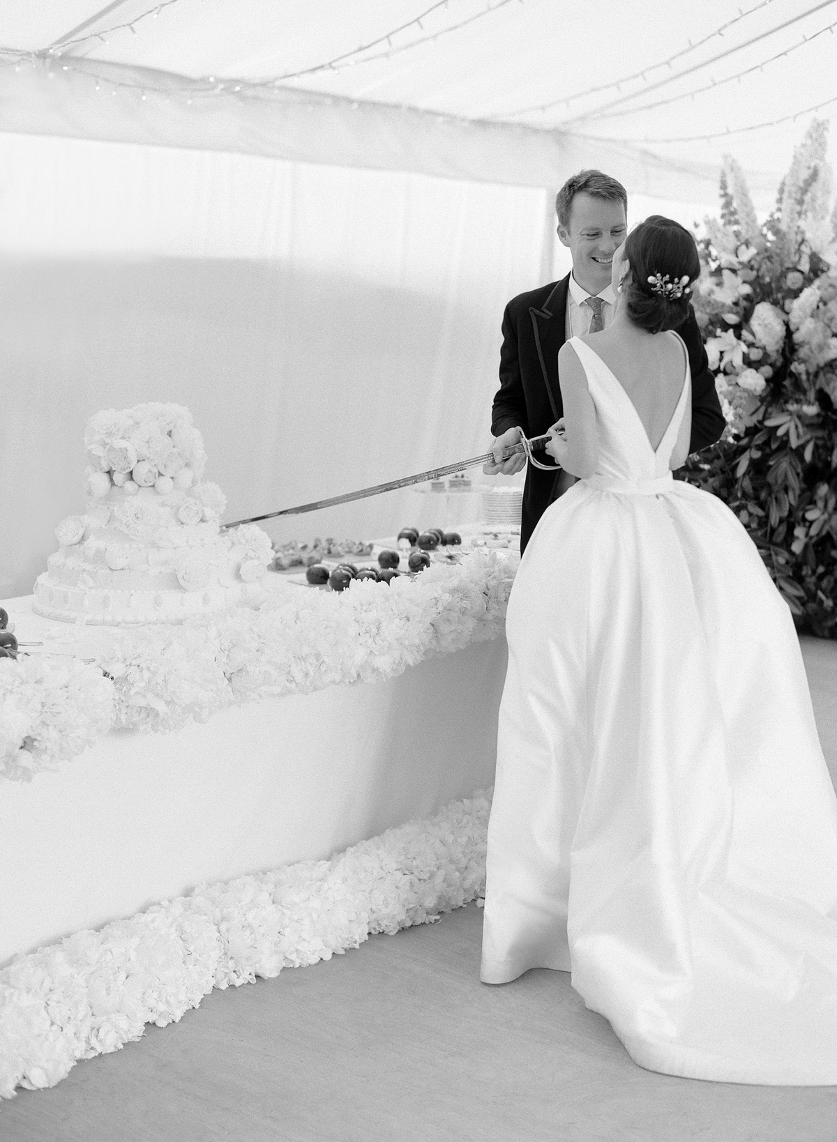 peony matthew england wedding couple cutting cake with sword
