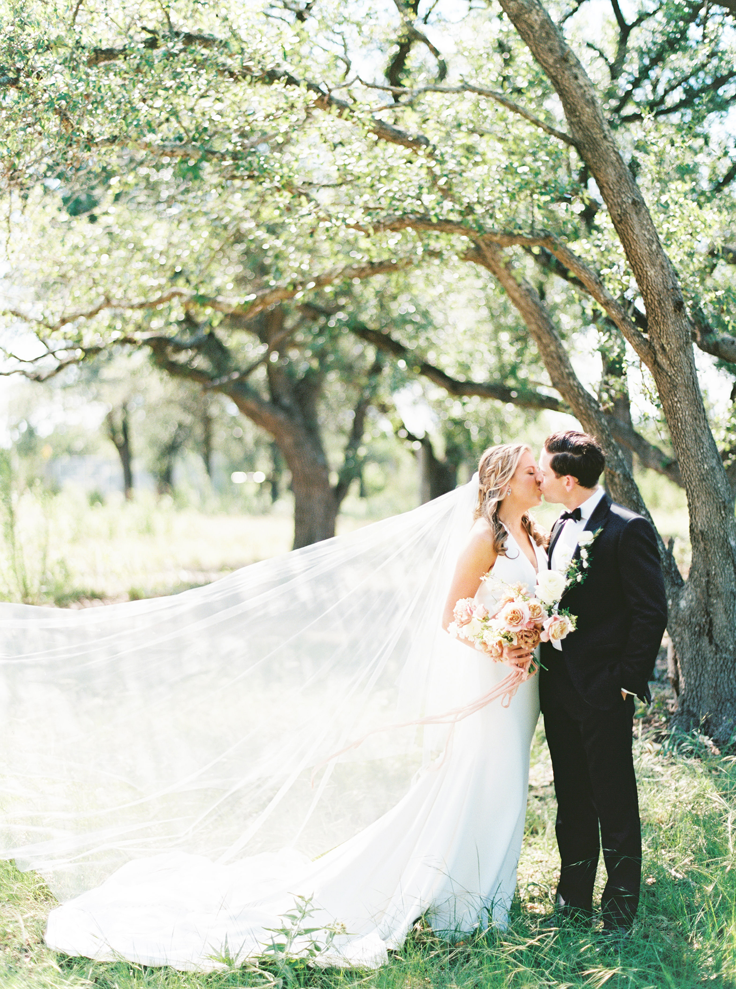 amanda chuck wedding couple kiss under the trees