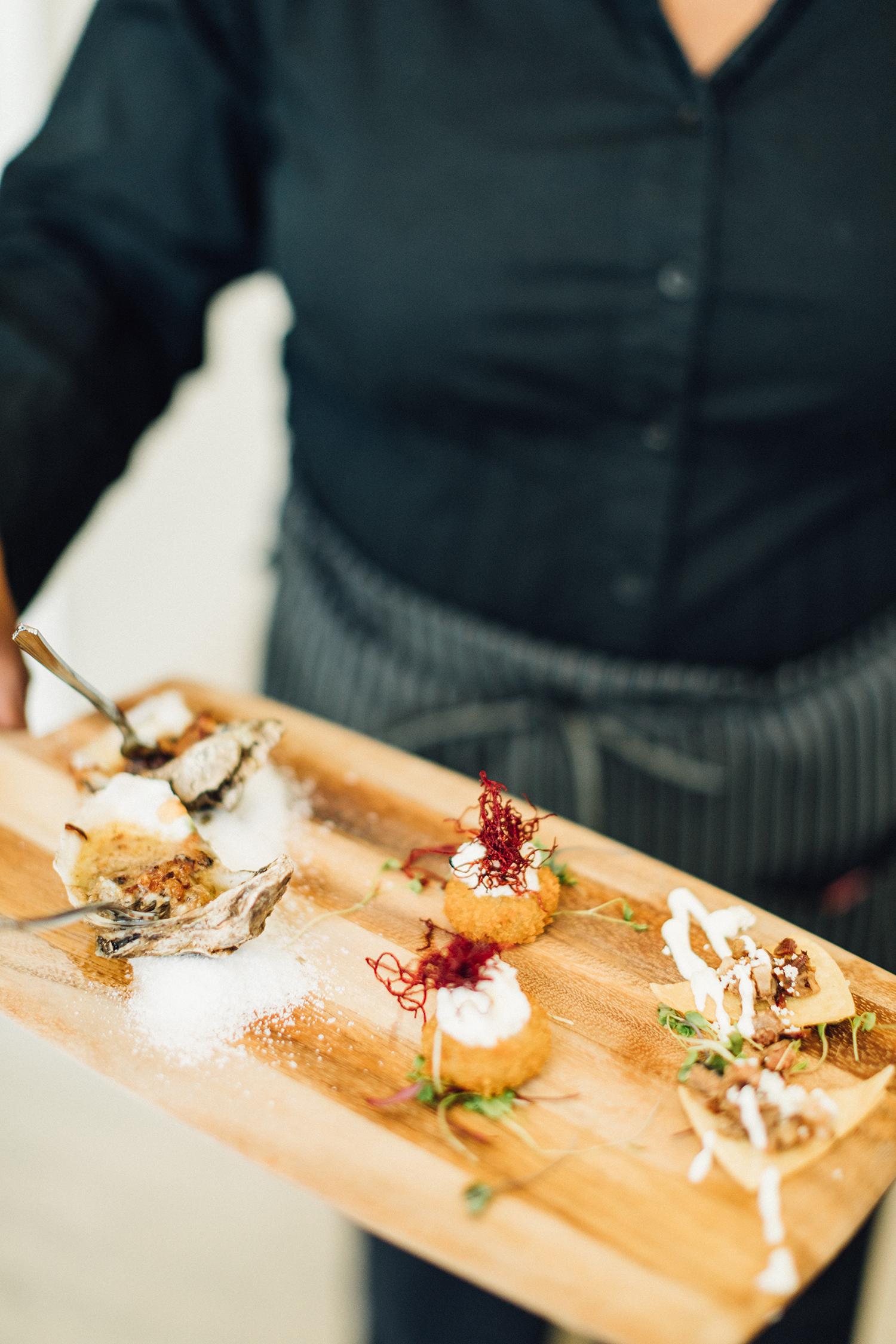 amanda chuck wedding appetizers on wooden tray