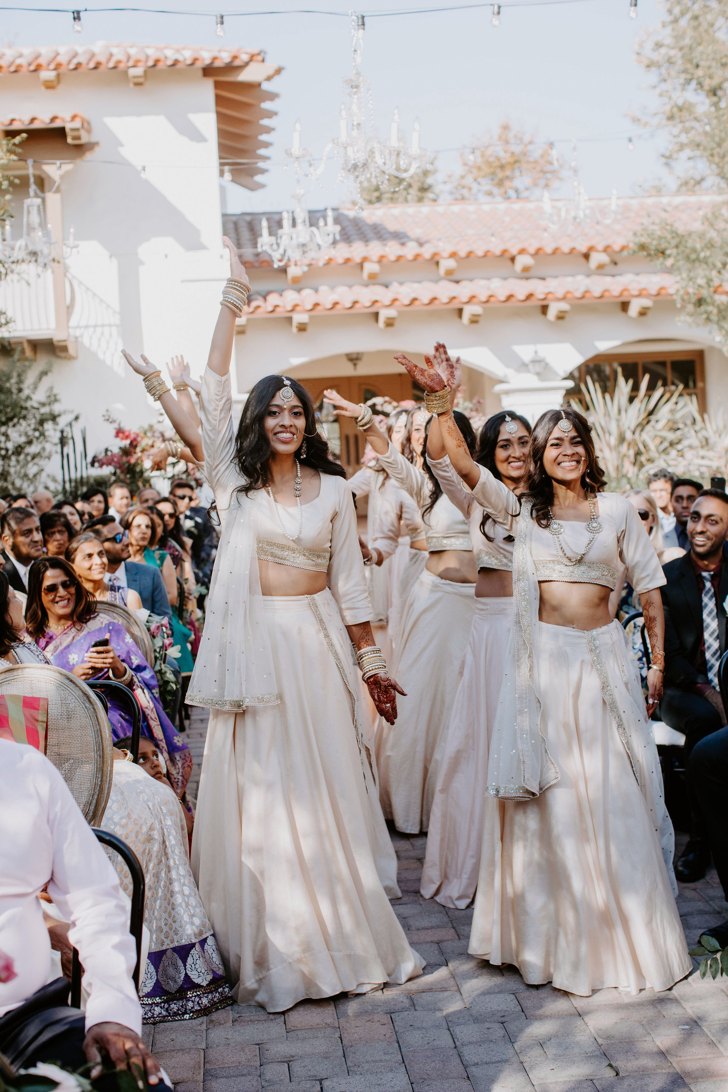 outdoor wedding bridesmaids dance indian cermony