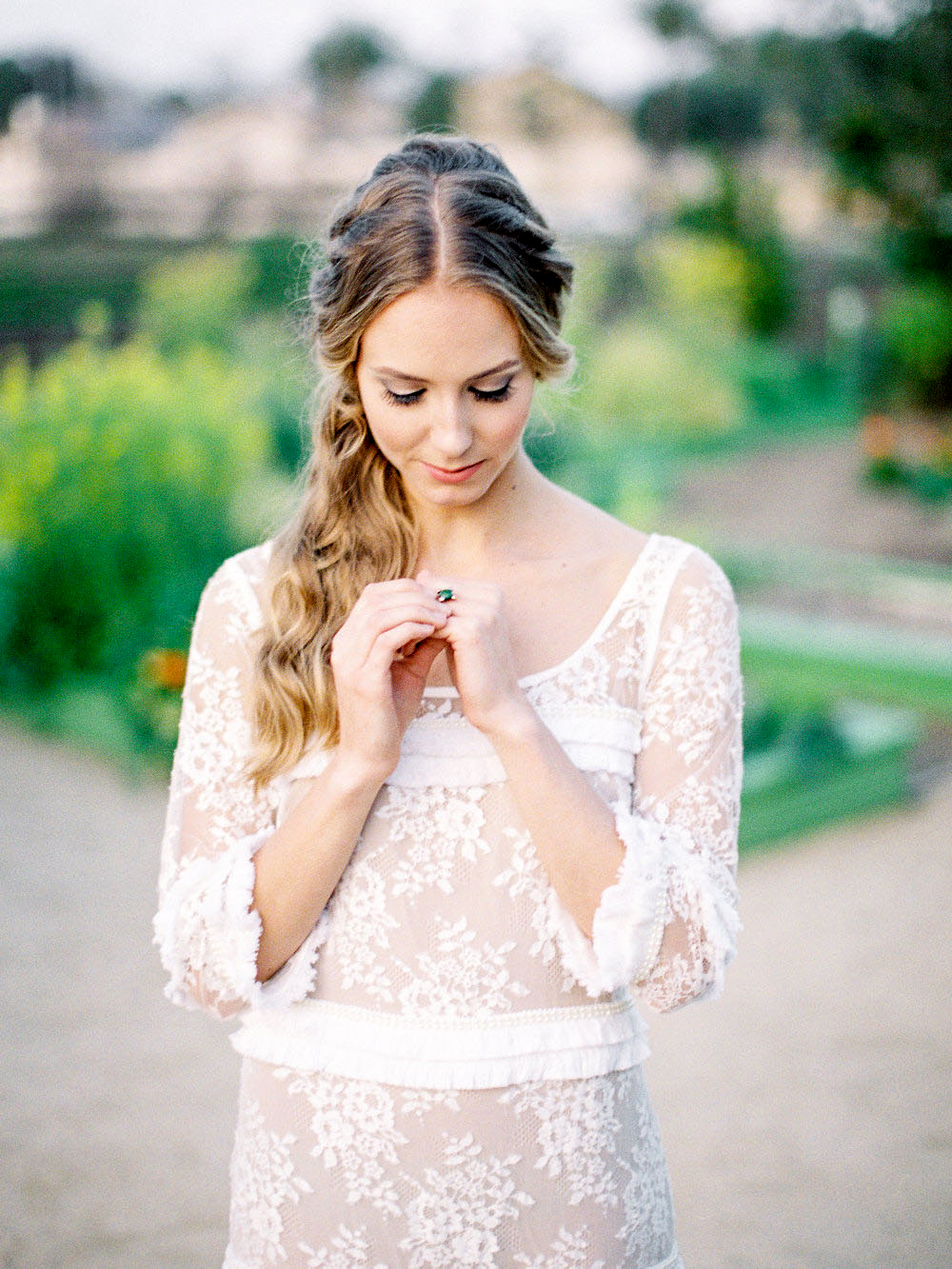 boho bride with twisted side-swept hairstyle