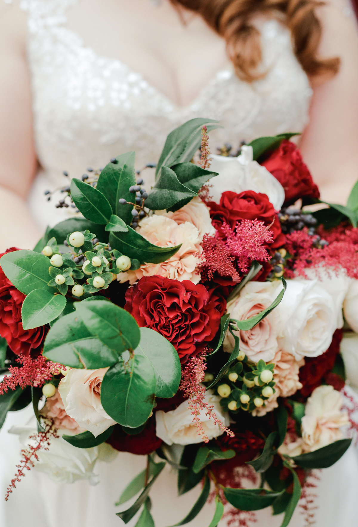 elizabeth seth wedding brides red and green bouquet