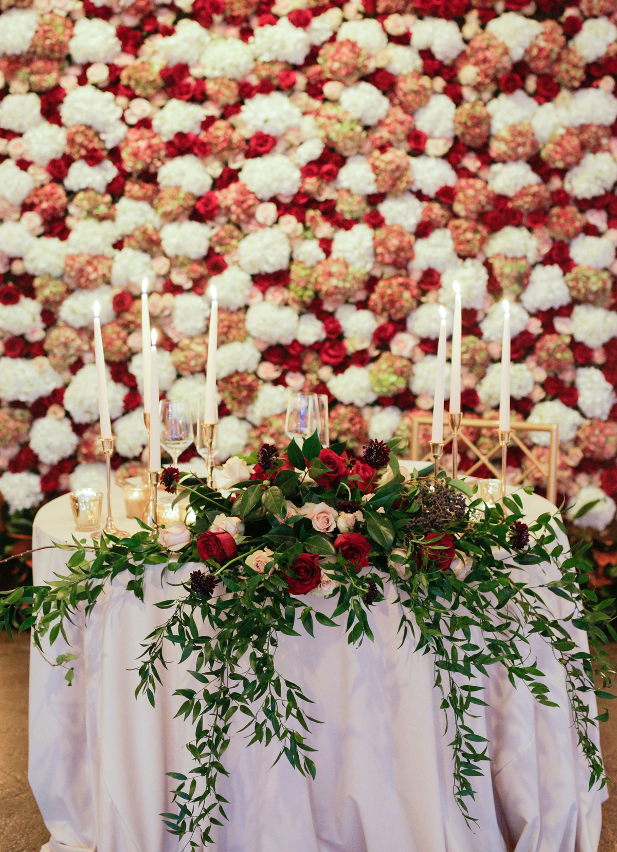 elizabeth seth wedding sweetheart table with flower wall backdrop