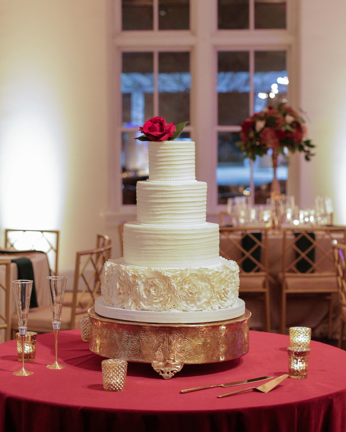 elizabeth seth wedding cake topped with a red rose