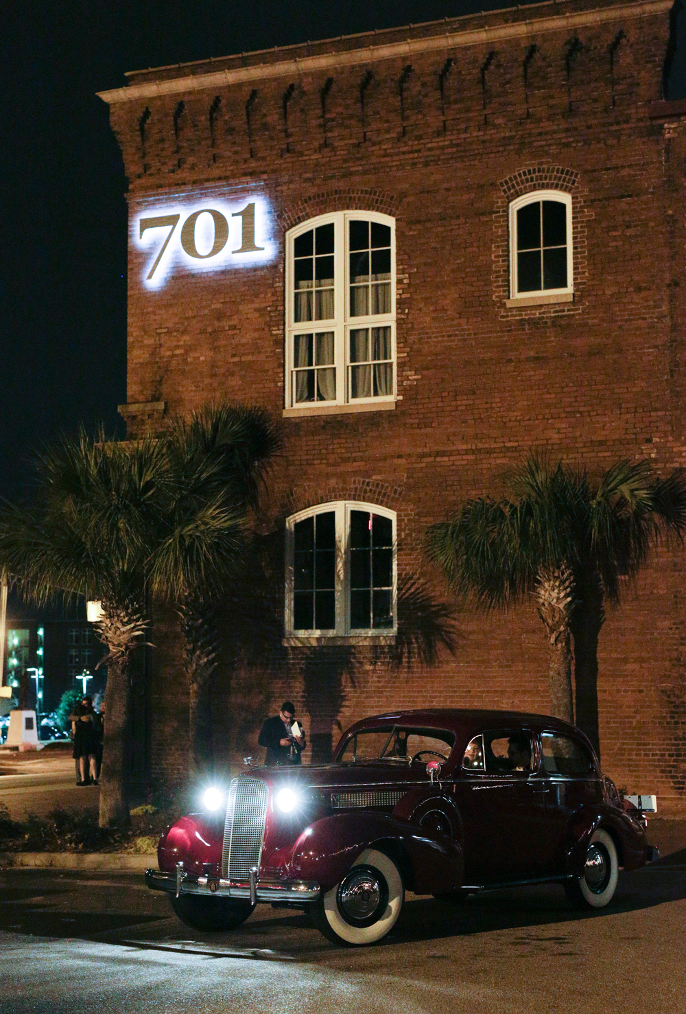 elizabeth seth wedding vintage car with headlights on outside of venue