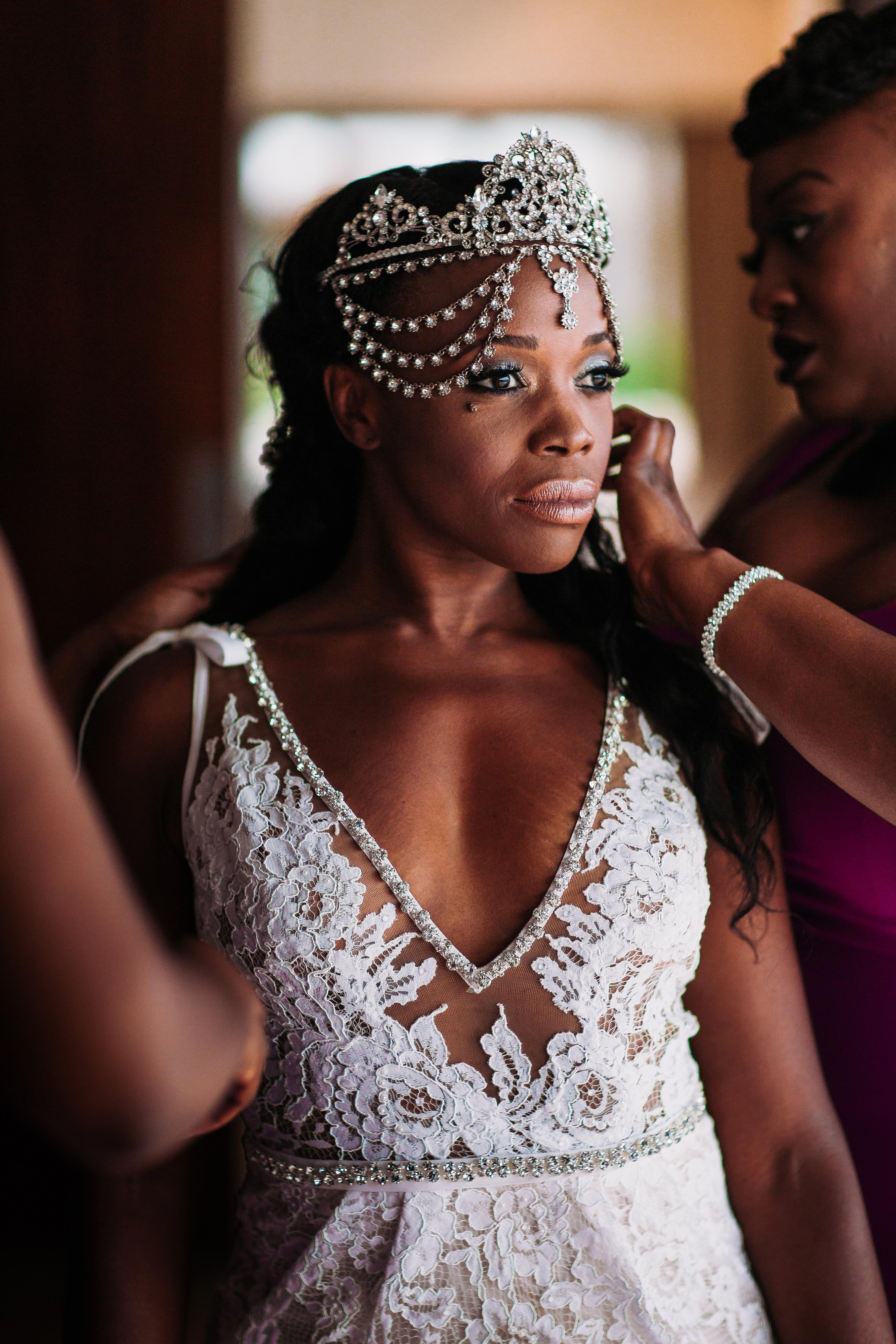 bride with v-beck floral dress diamond head piece