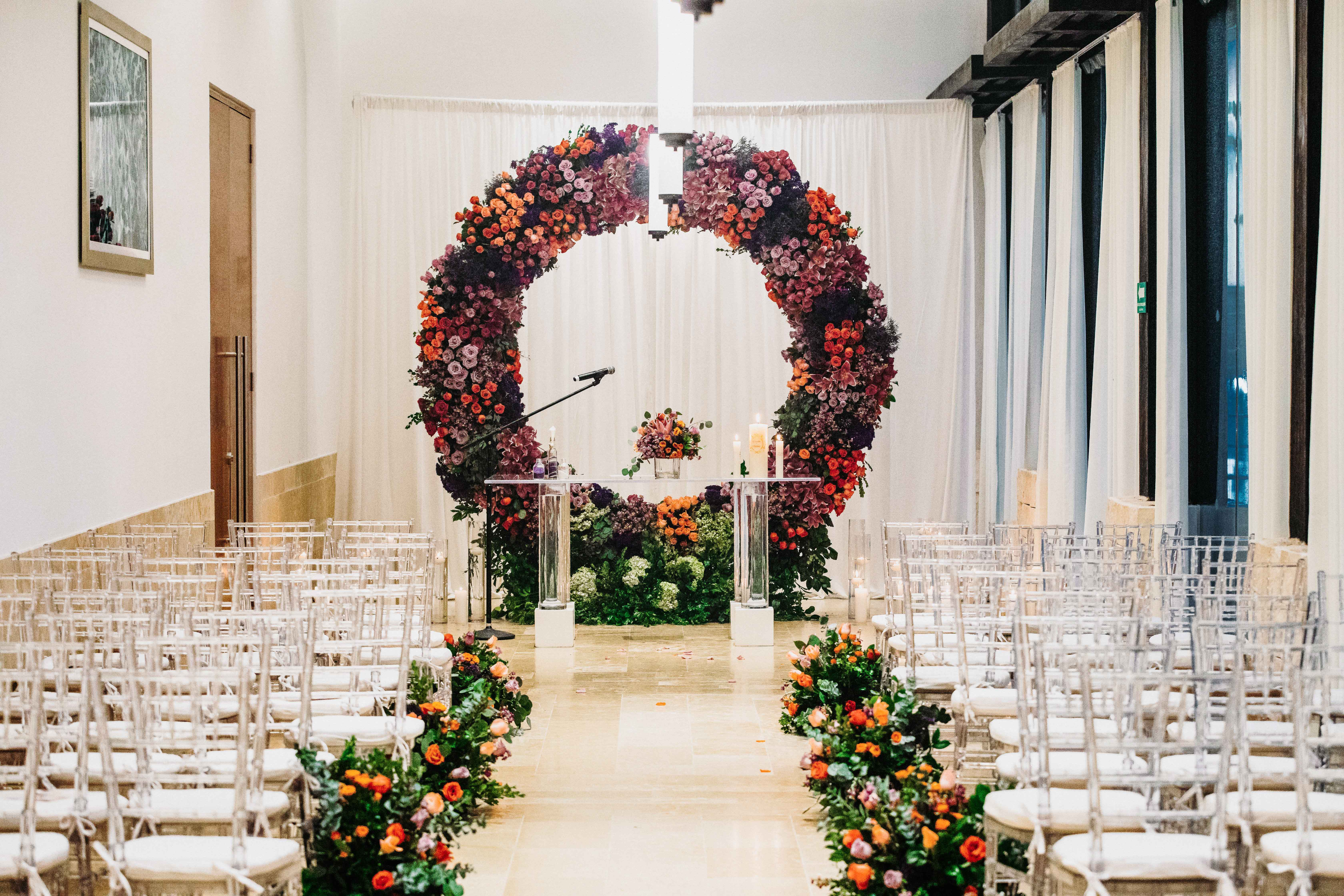 wedding ceremony seating floral circle arch