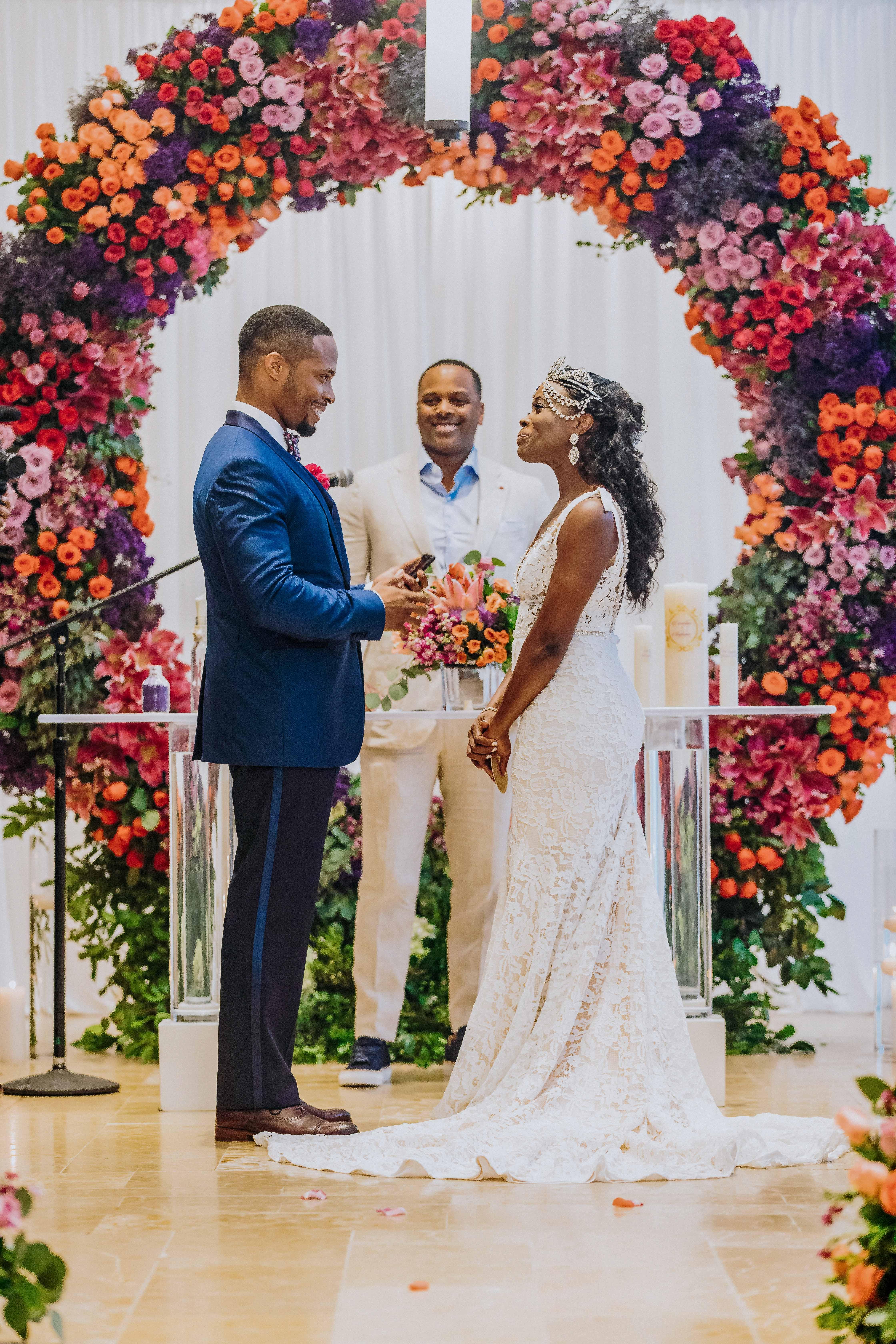 bride groom wedding ceremony vows floral arch