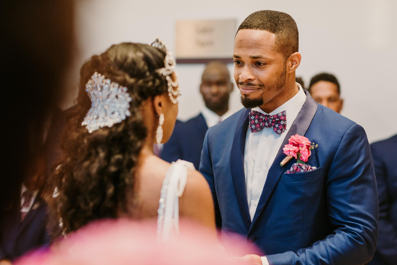 groom smiling at bride wedding ceremony