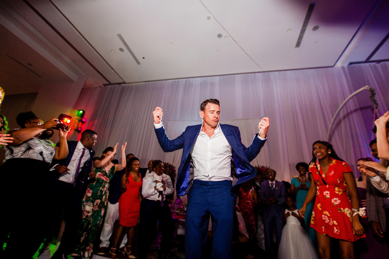 wedding reception man in blue suit dancing
