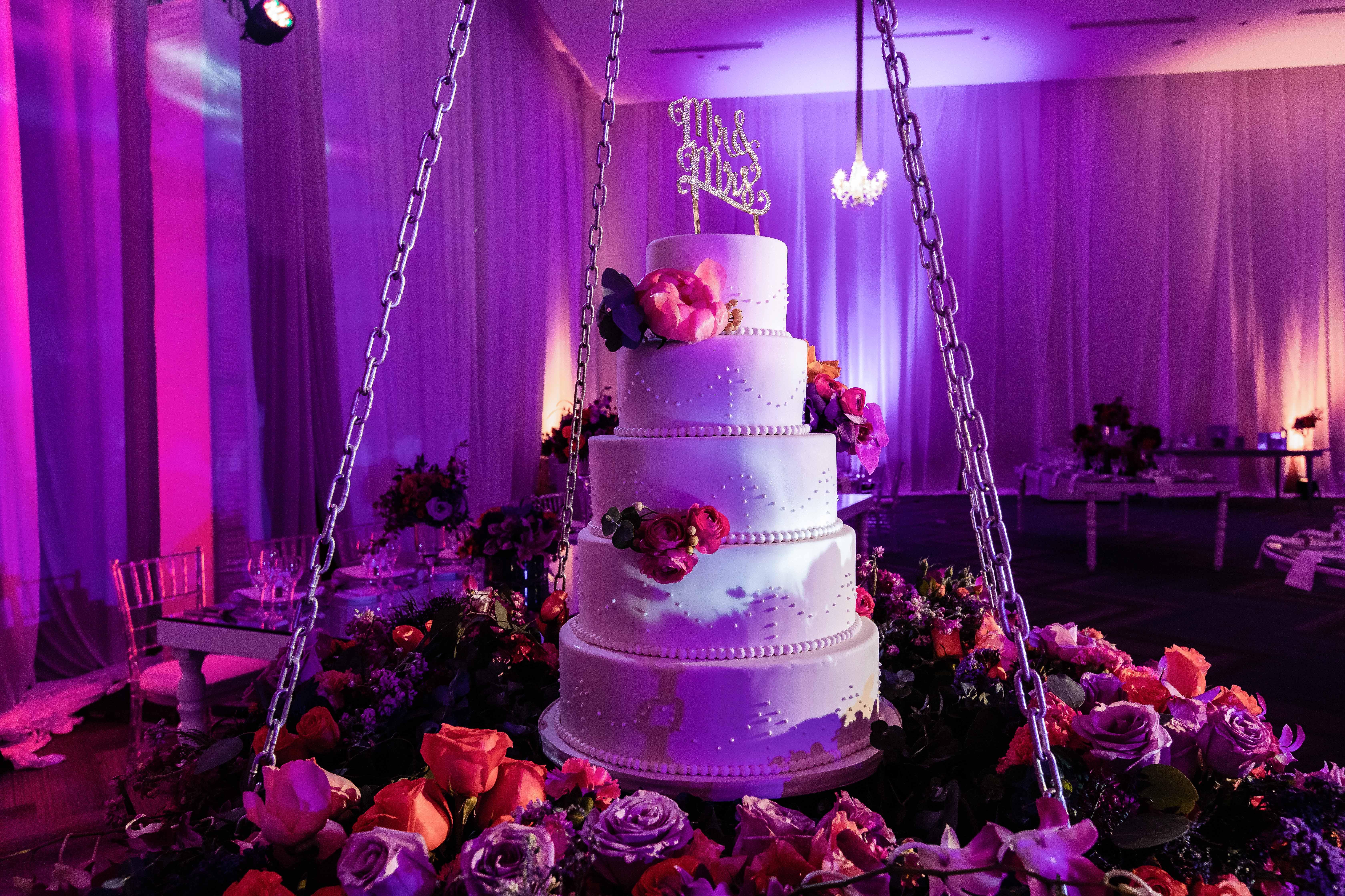 hanging five tier wedding cake rose base pink lighting