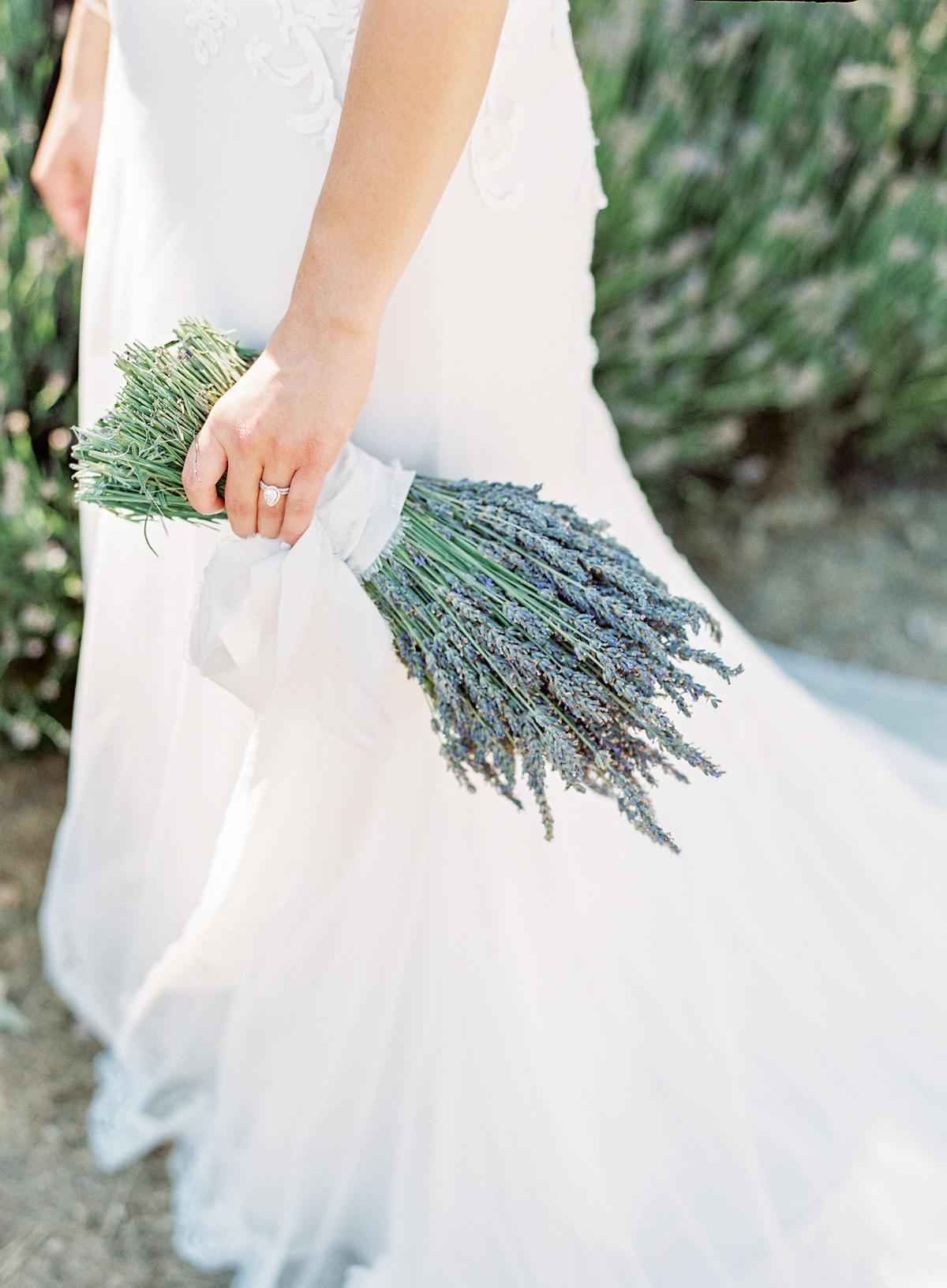 single flower wedding bouquet lavender bundled with white ribbon