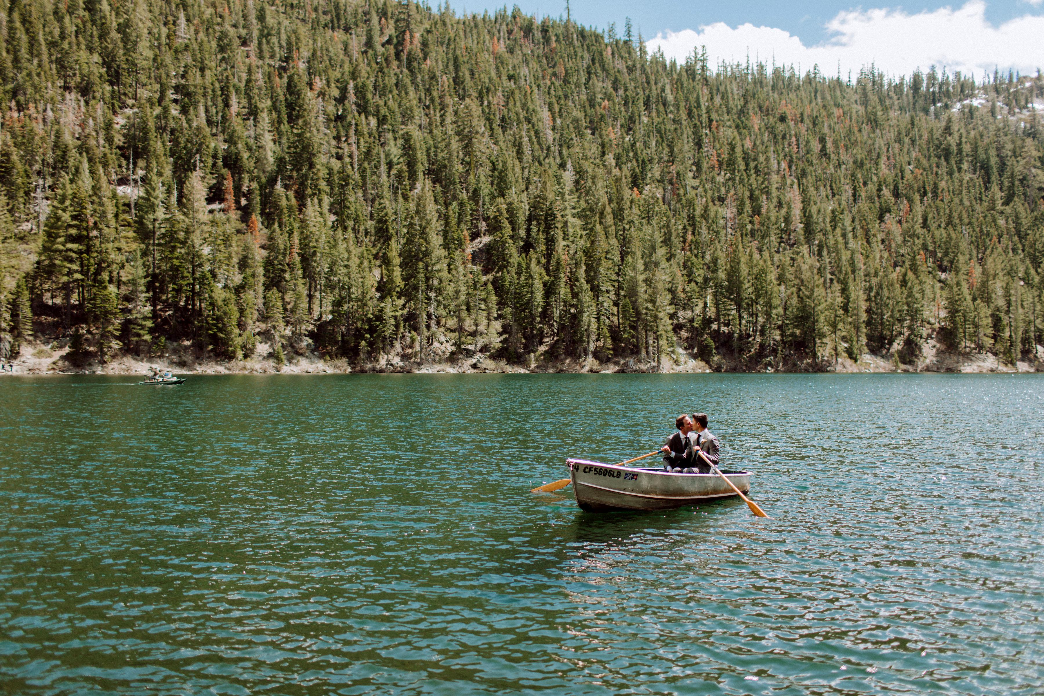 Court & Kelsey kissing in canoe on lake