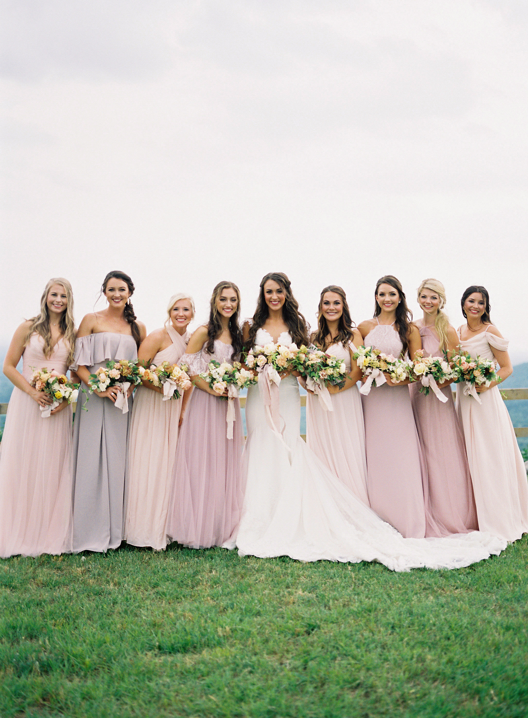 bride and bridesmaids outdoors pink shade dresses
