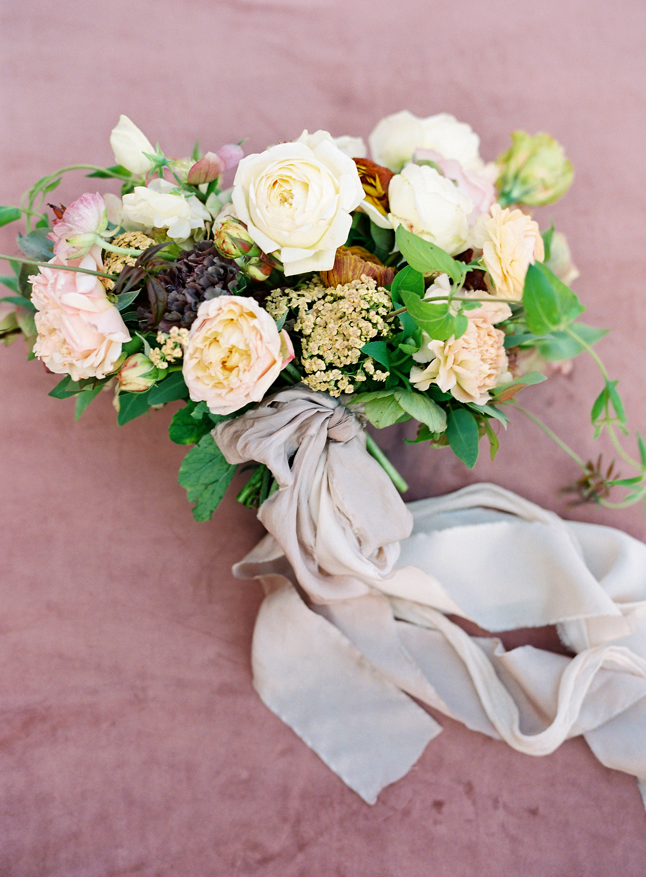 bride wedding bouquet peach gold flowers with greenery