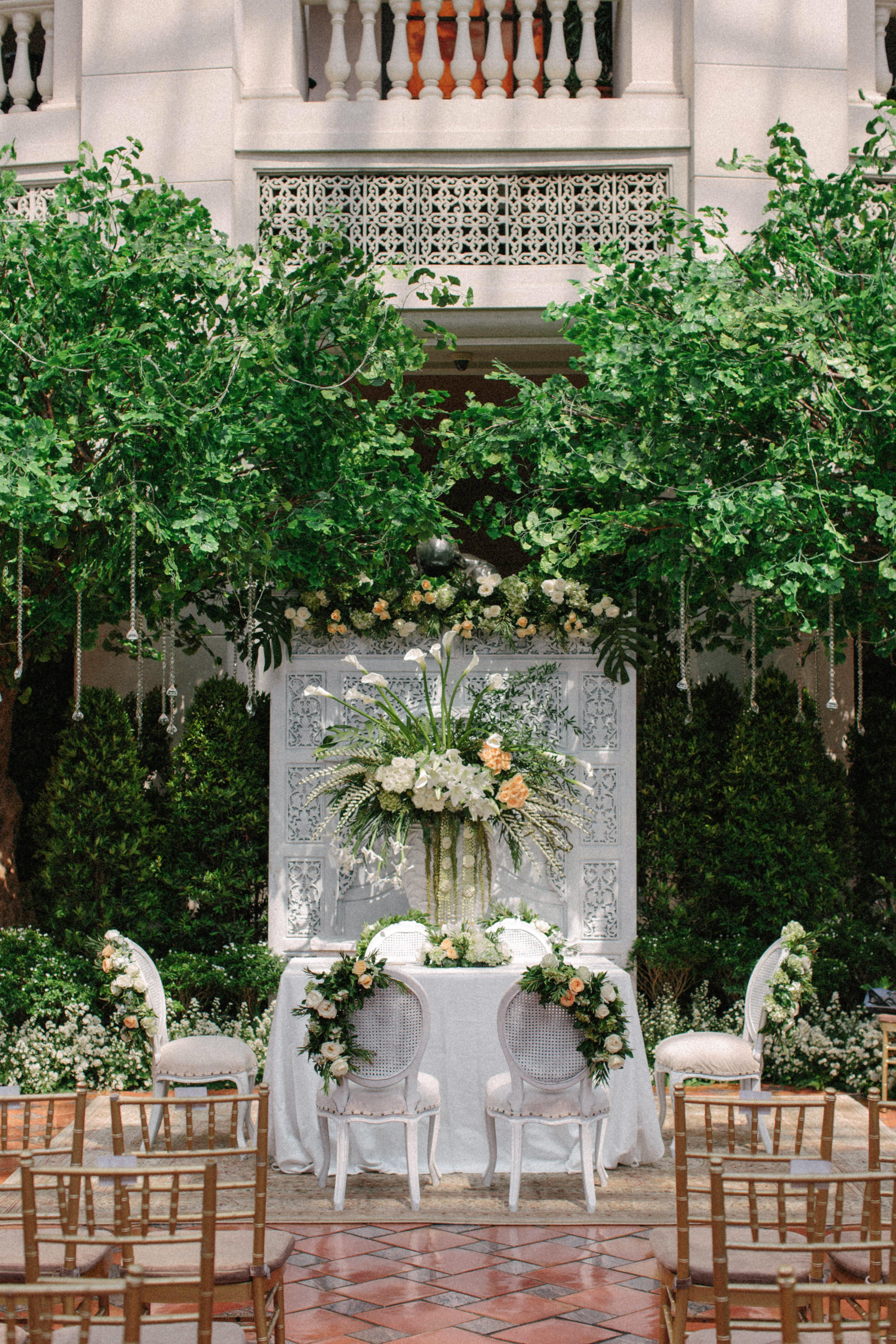 wedding ceremony table floral greenery backdrop centerpiece