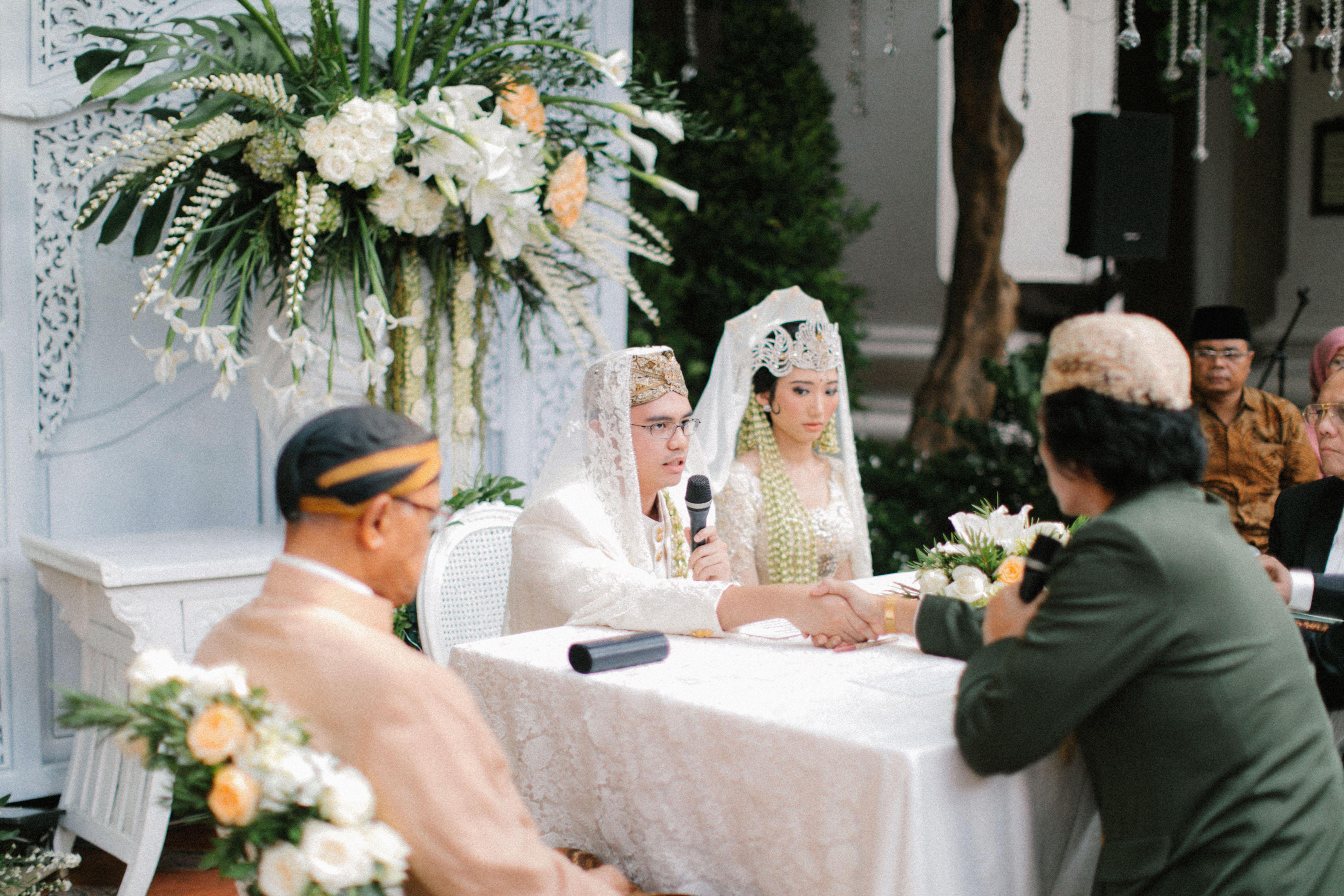 wedding ceremony table vows bride groom father handshake