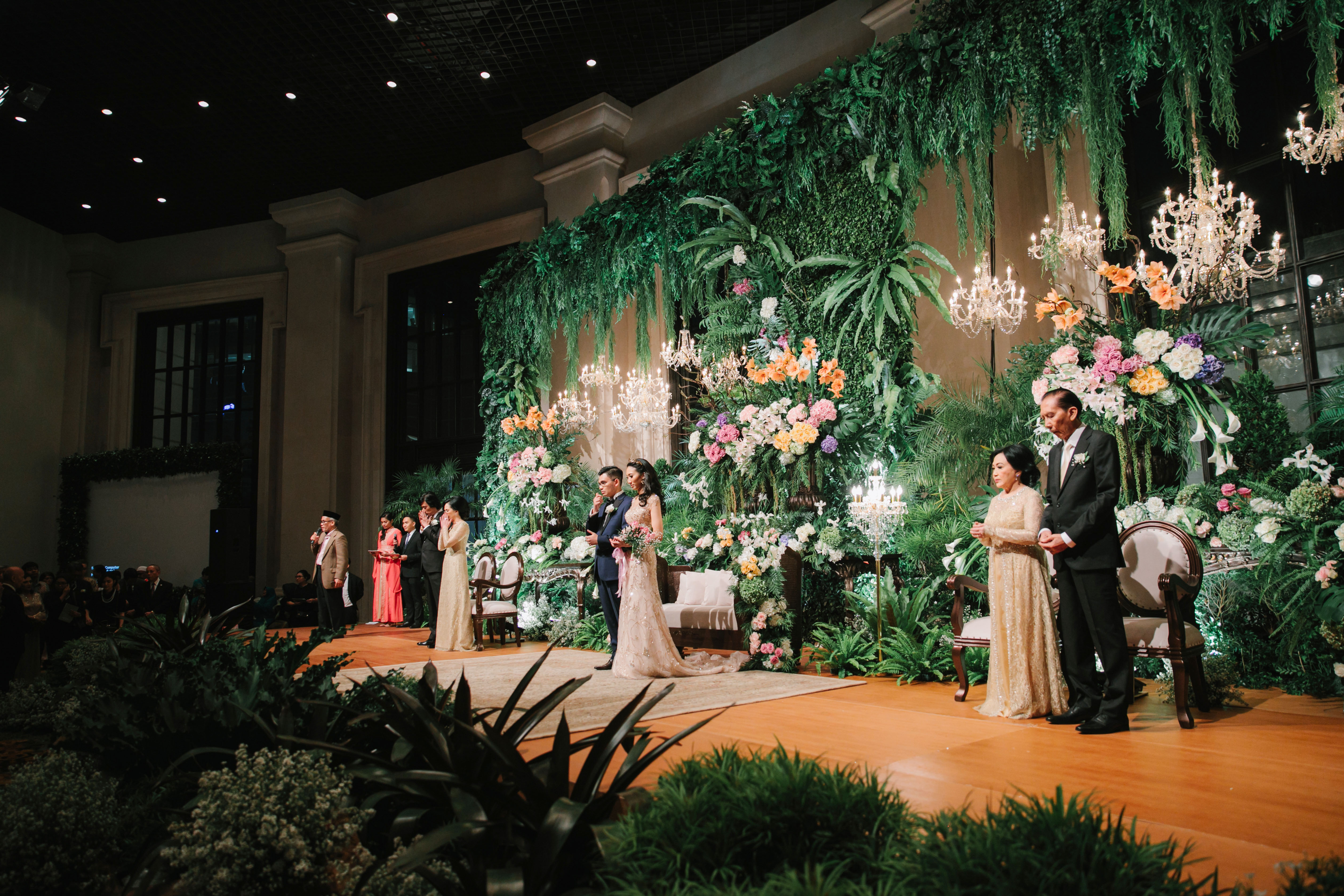 wedding reception stage enchanted forest garden decor