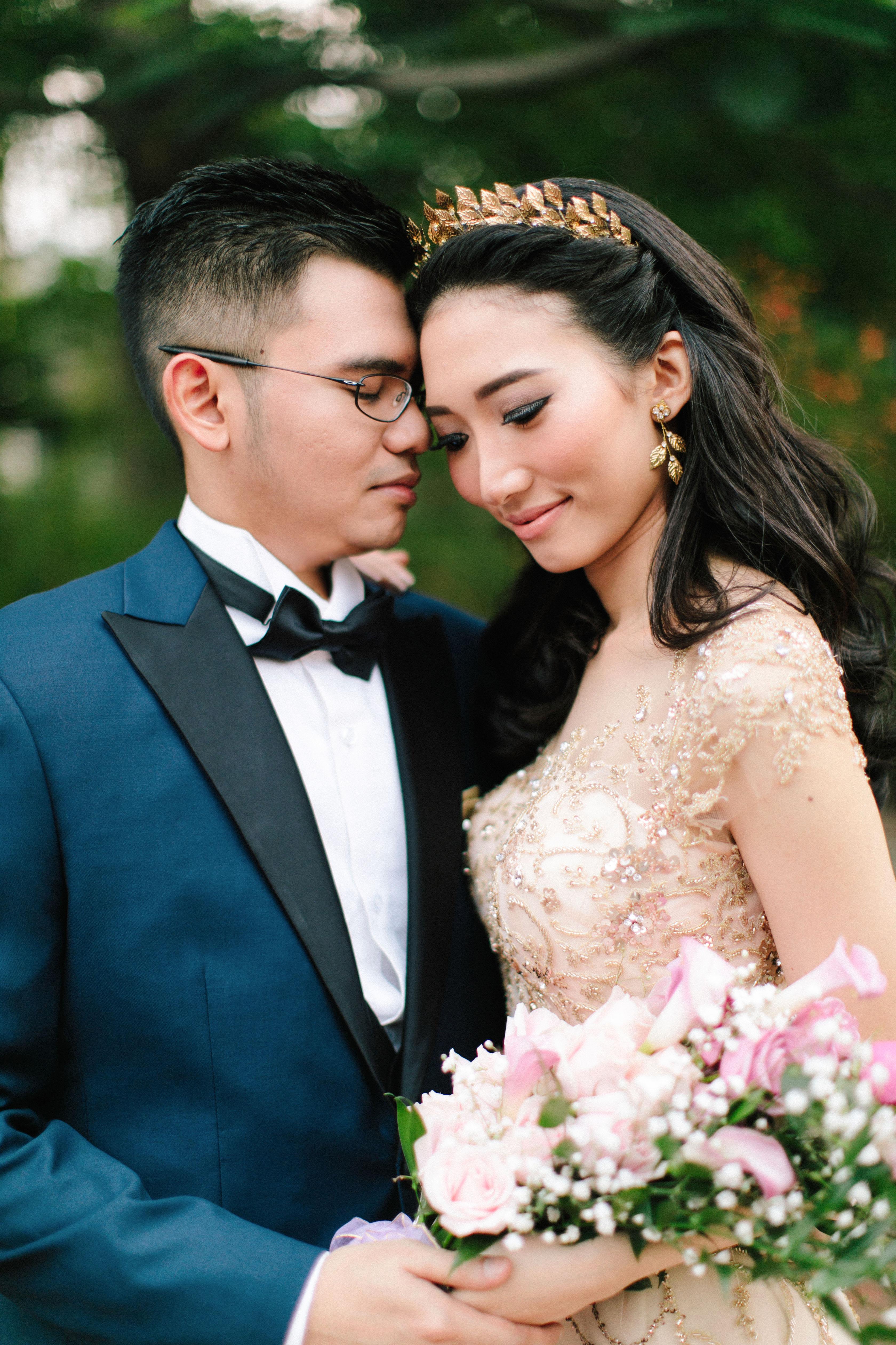 wedding couple groom blue tux bride holding bouquet