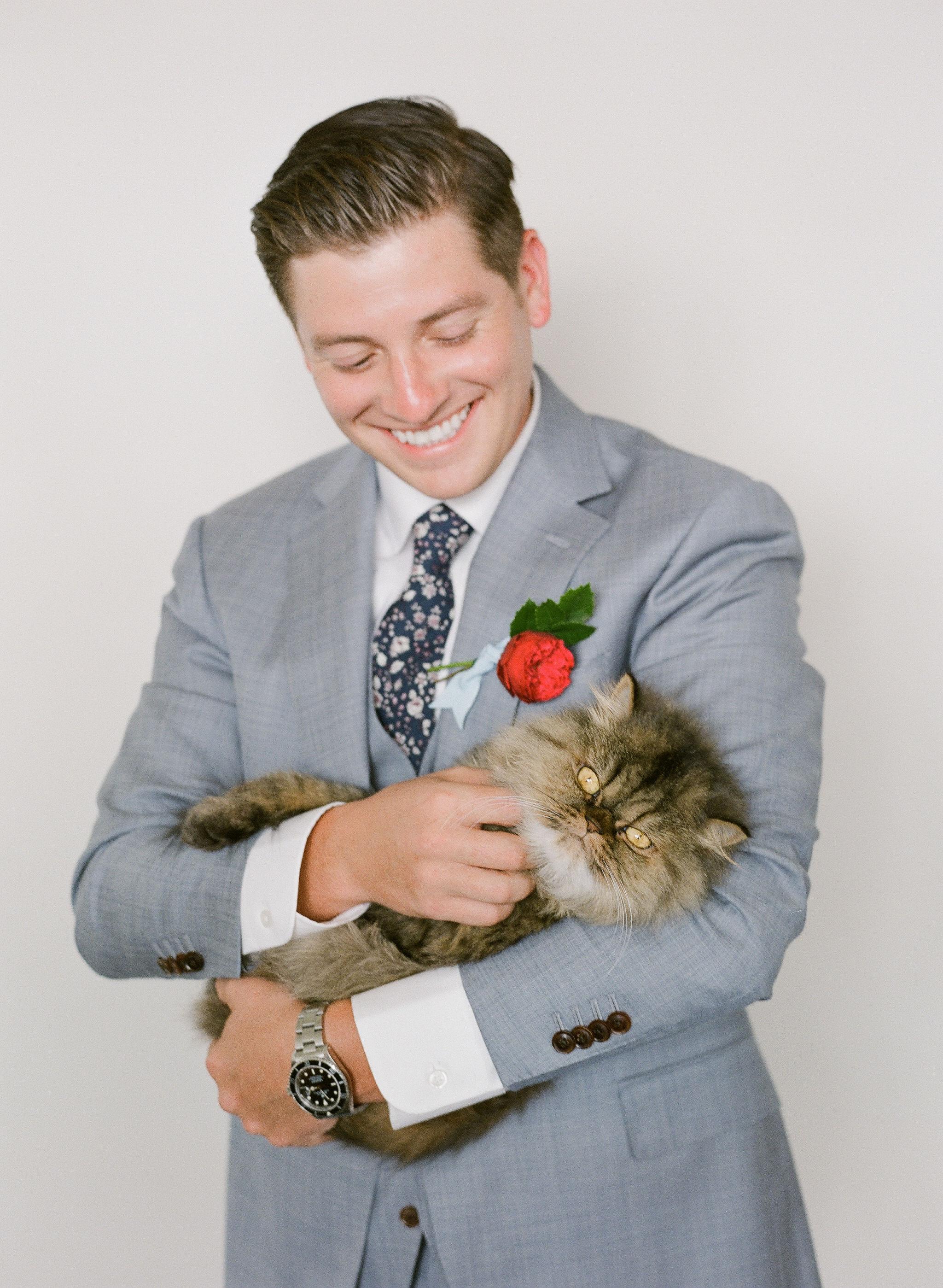 colleen stephen newport wedding groom holding cat