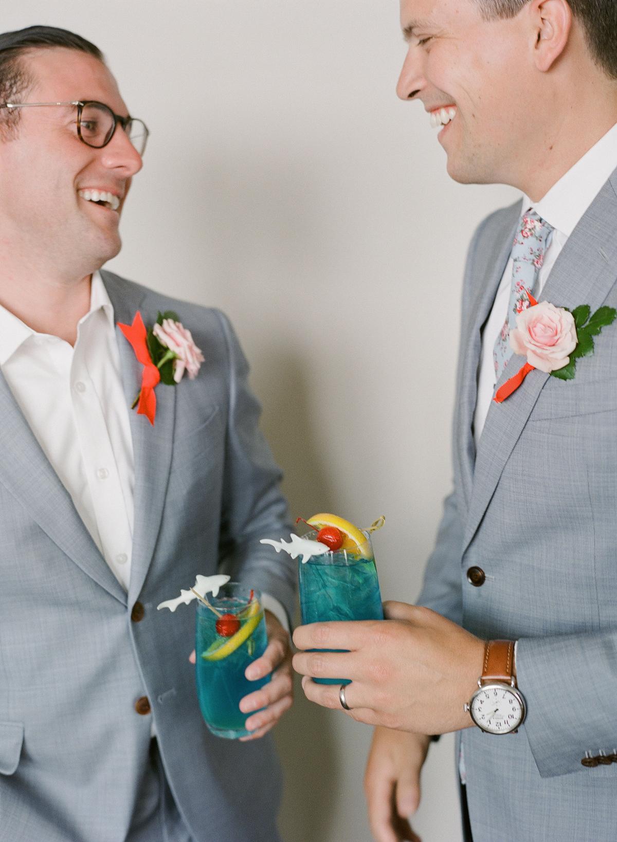 colleen stephen newport wedding men with blue cocktails