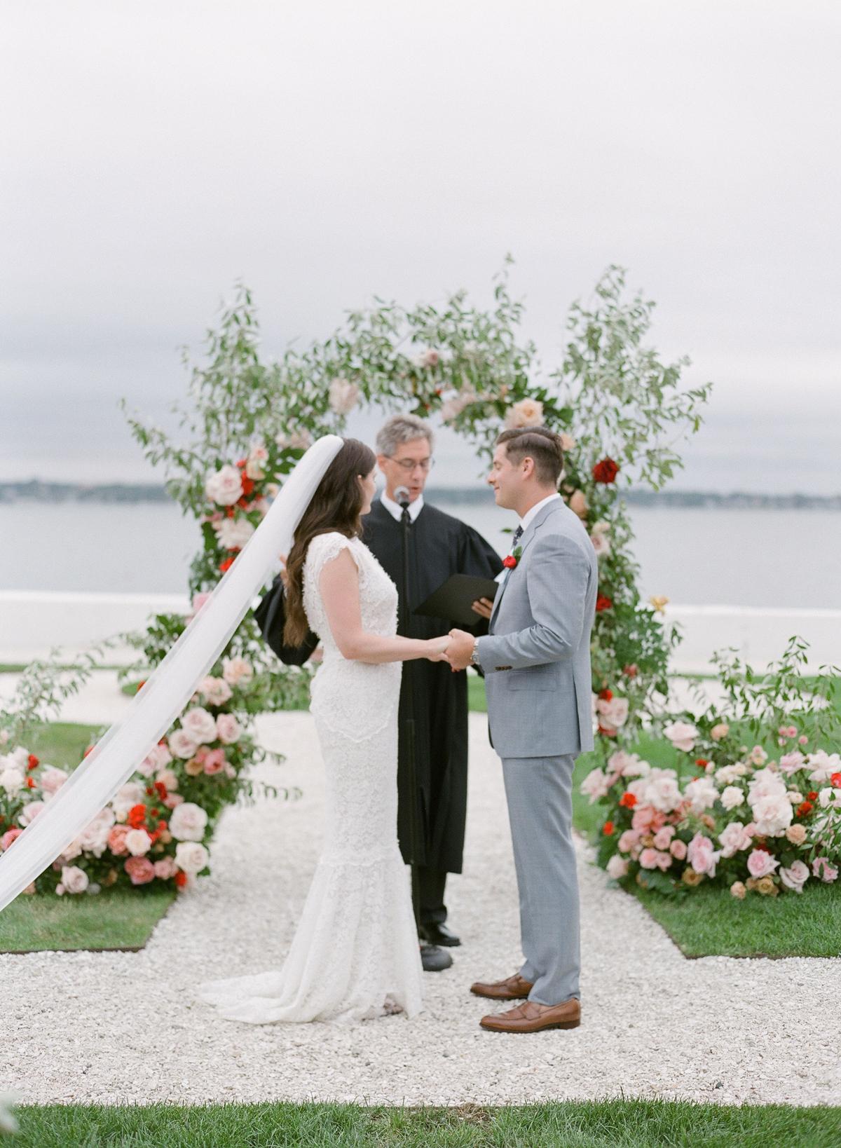 colleen stephen newport wedding ceremony couple holding hands
