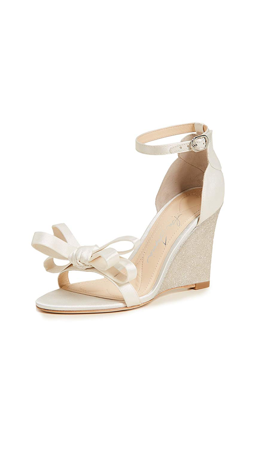 wedding wedges with white bow in front