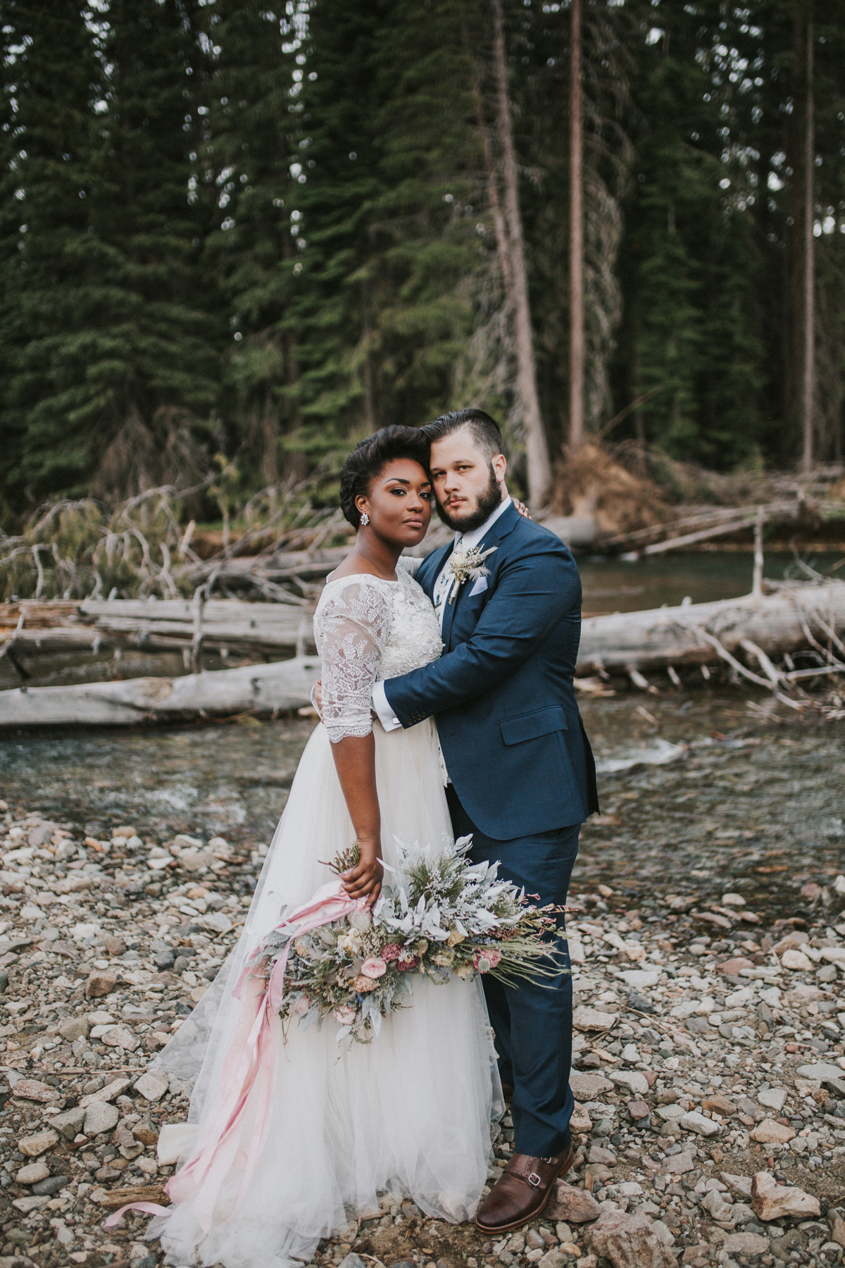 elopement outfit inspiration couple embracing in forest