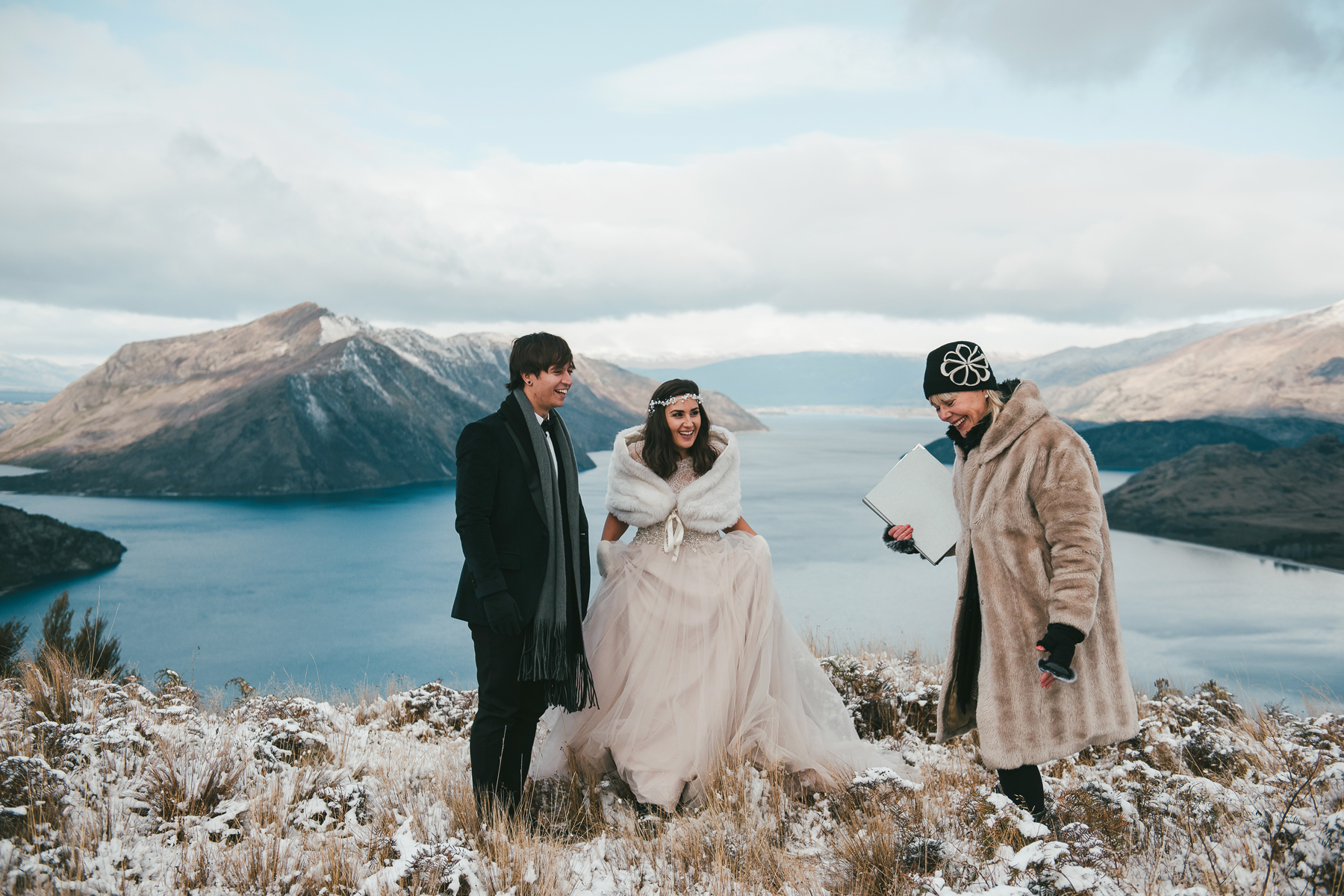elopement outfit inspiration couple on moped snowy mountain with officiant
