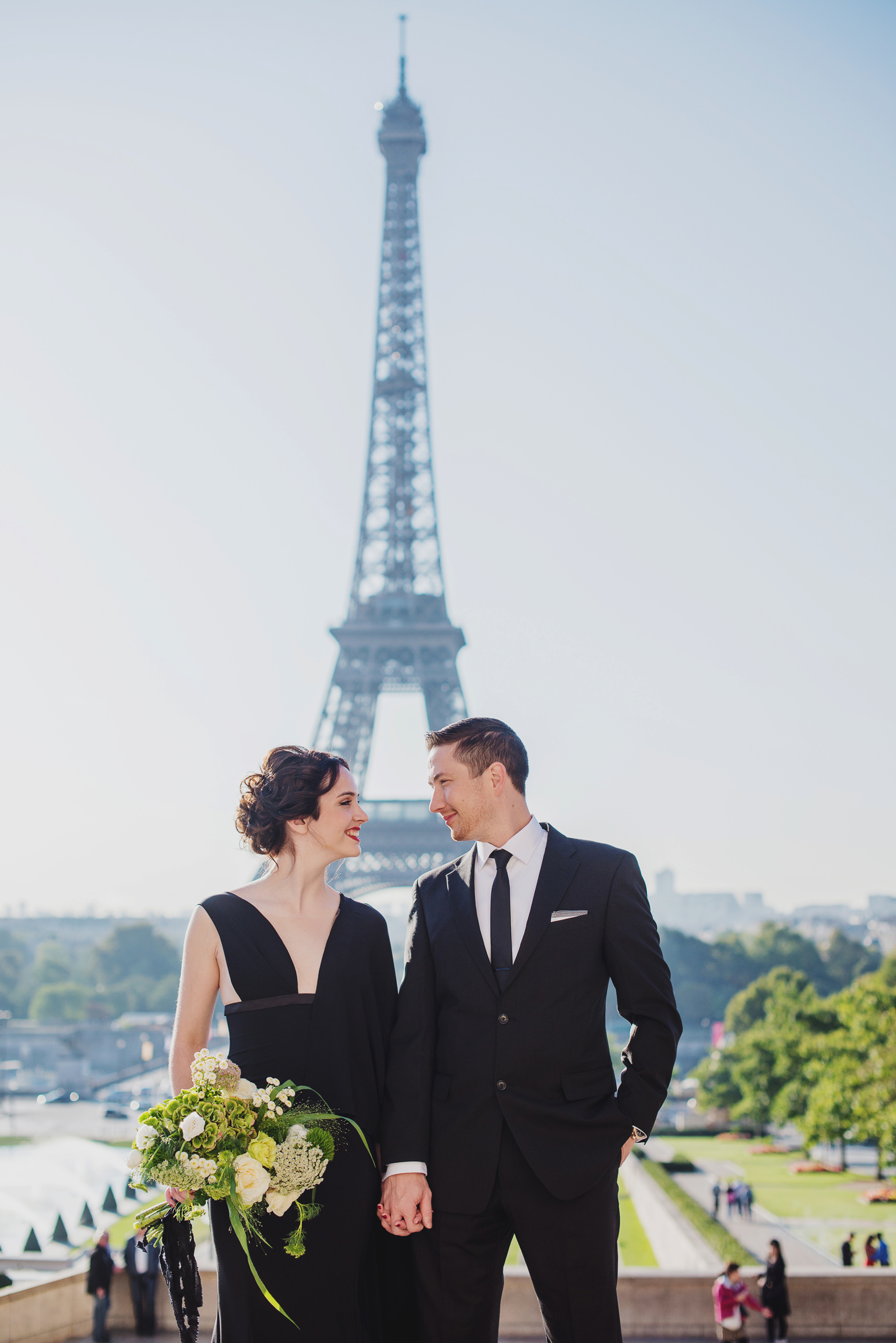elopement outfit inspiration couple in black with eiffel tower in background