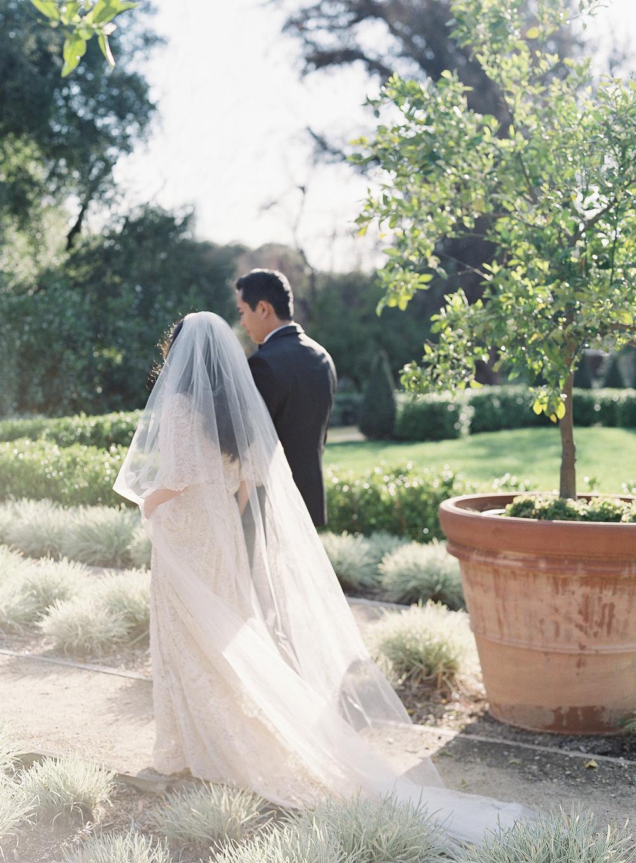 emme daji wedding couple walking through garden