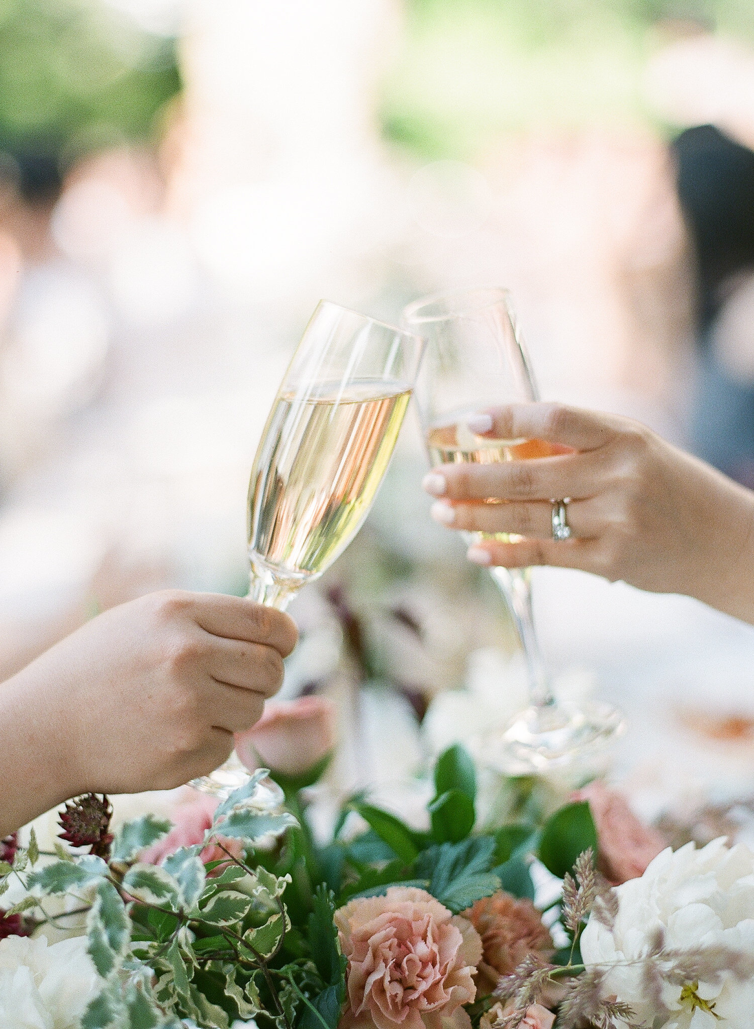 Guests Clinking Champagne Flutes During Toast