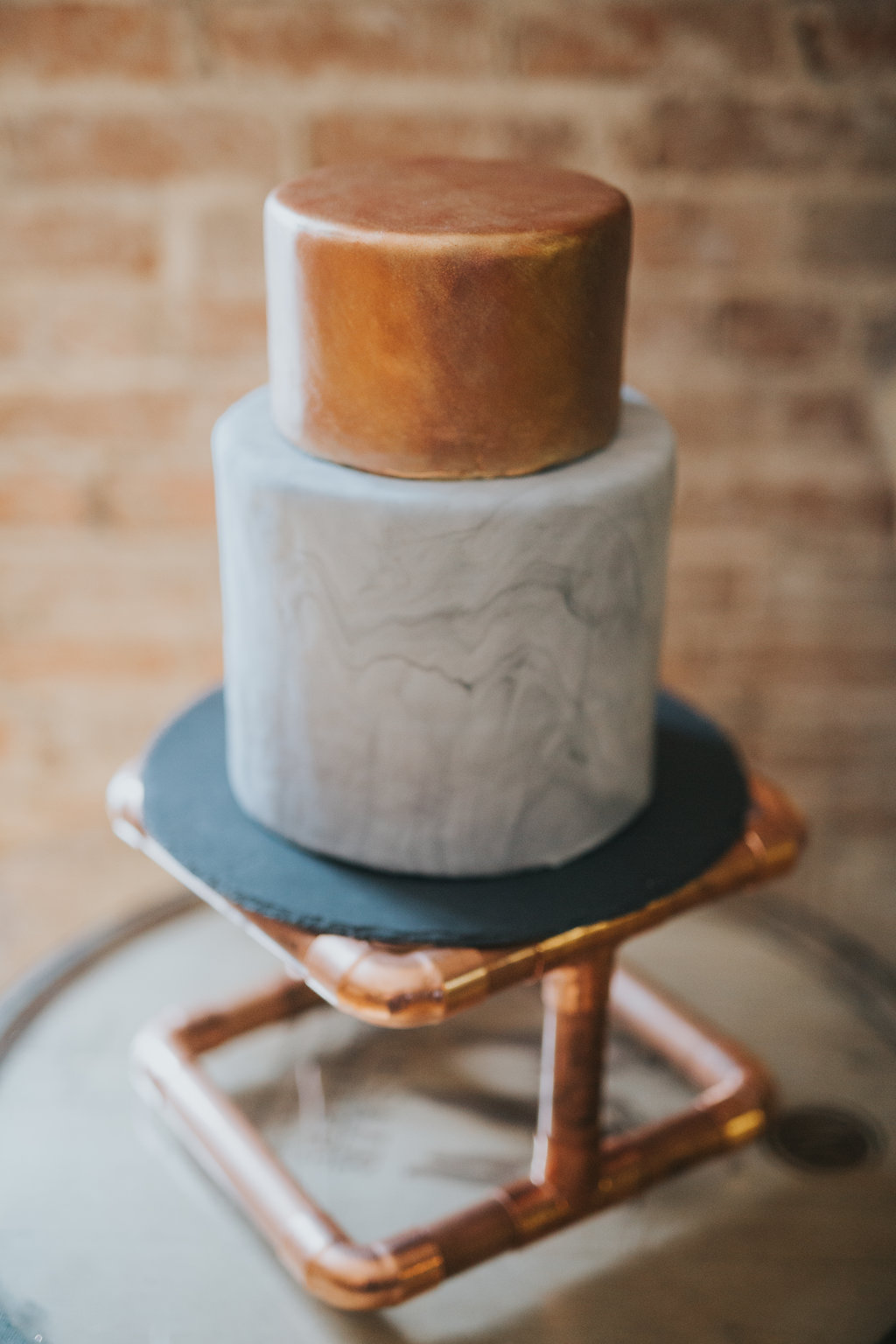 industrial cake stand with pipes