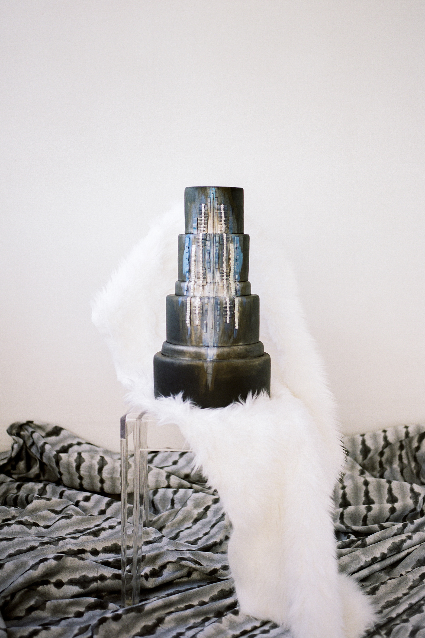 micro tier wedding cakes metallic with faux fur display