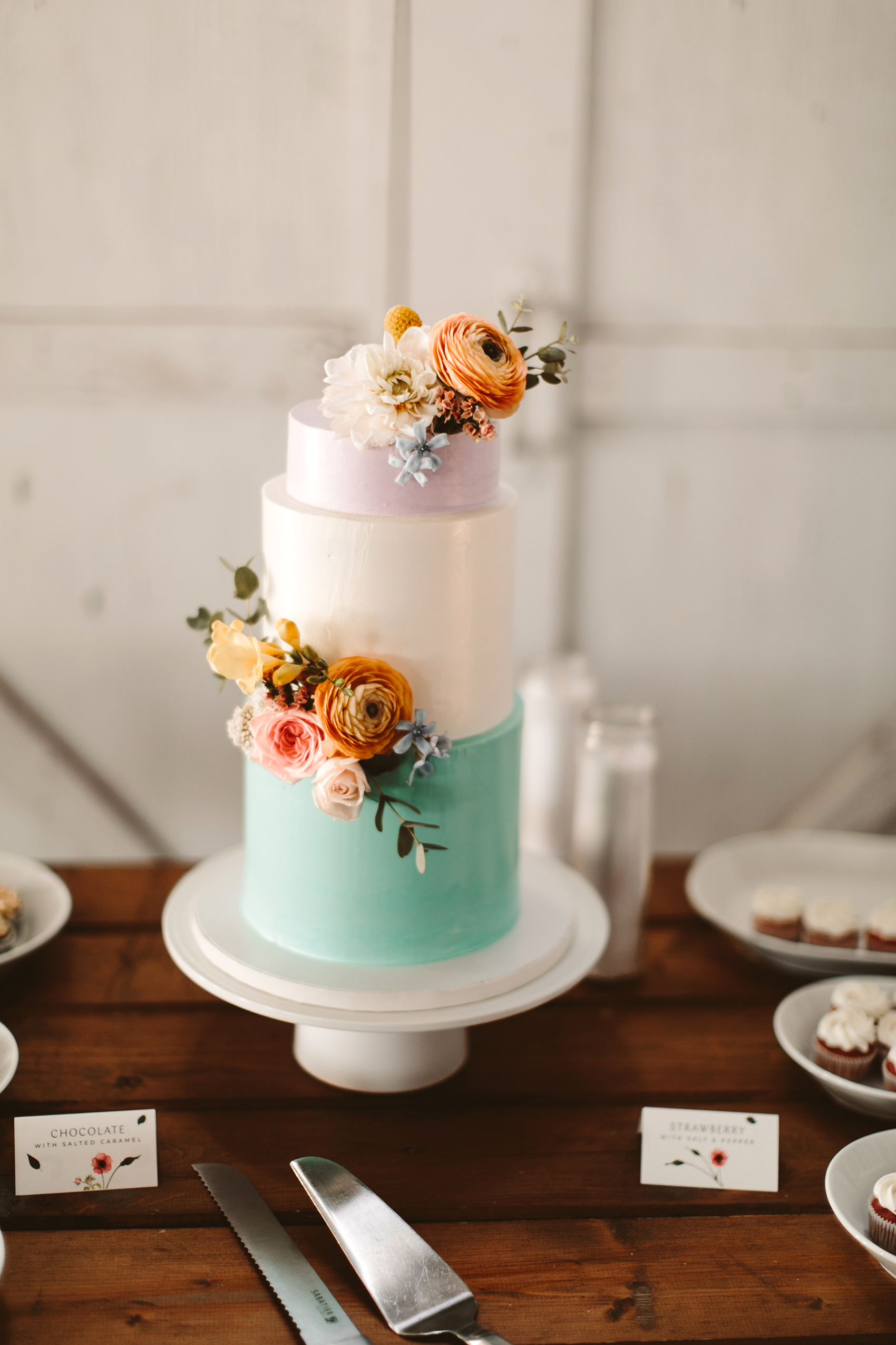 micro tier wedding cakes pastel sea foam and flowers