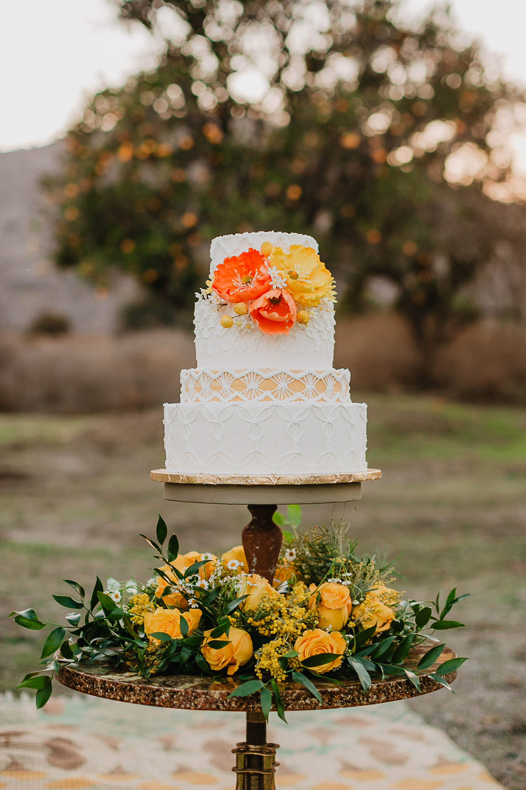 micro tier wedding cakes accent tier orange and white