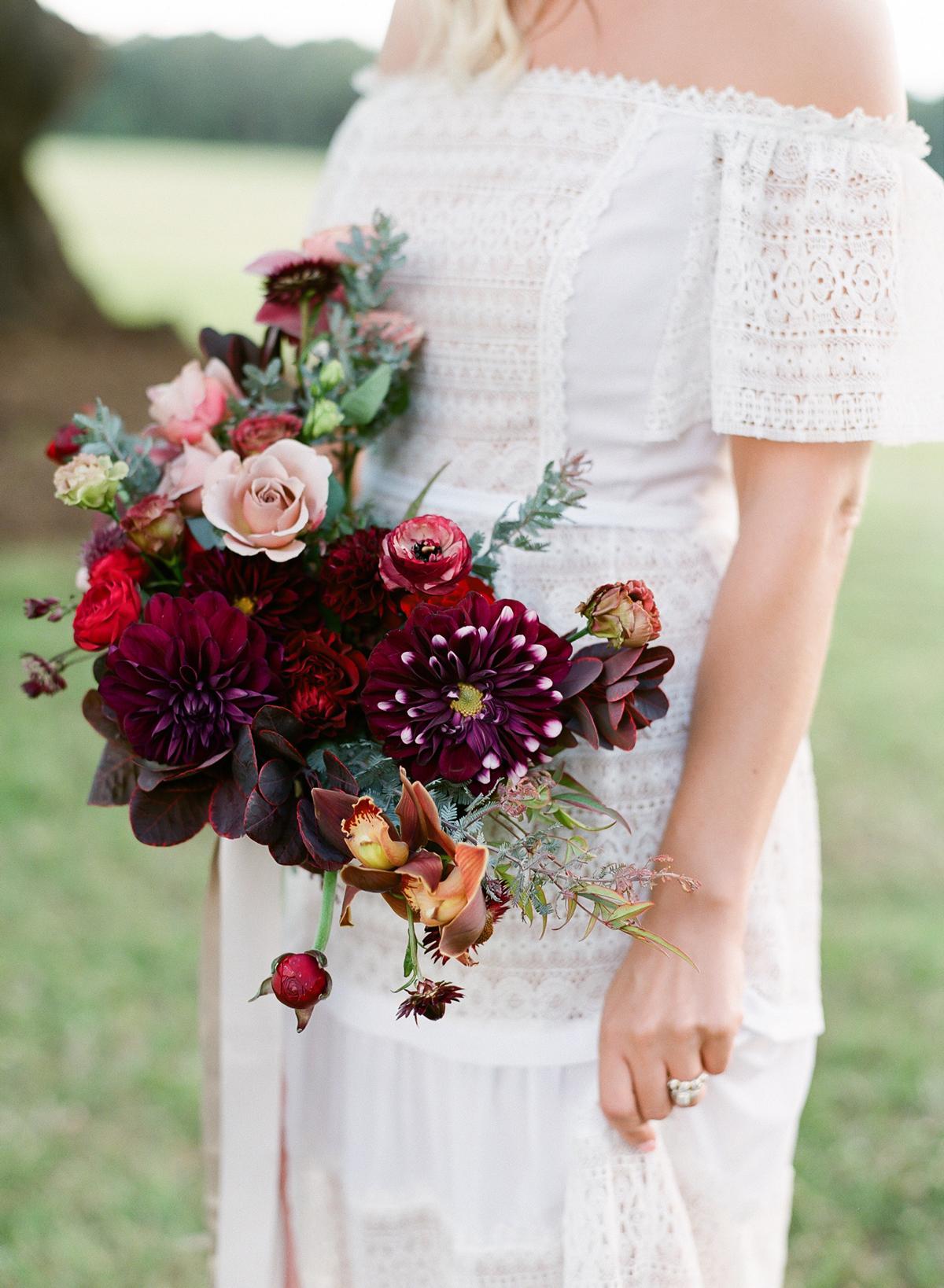 Bride wearing ivory crocheted lace dress