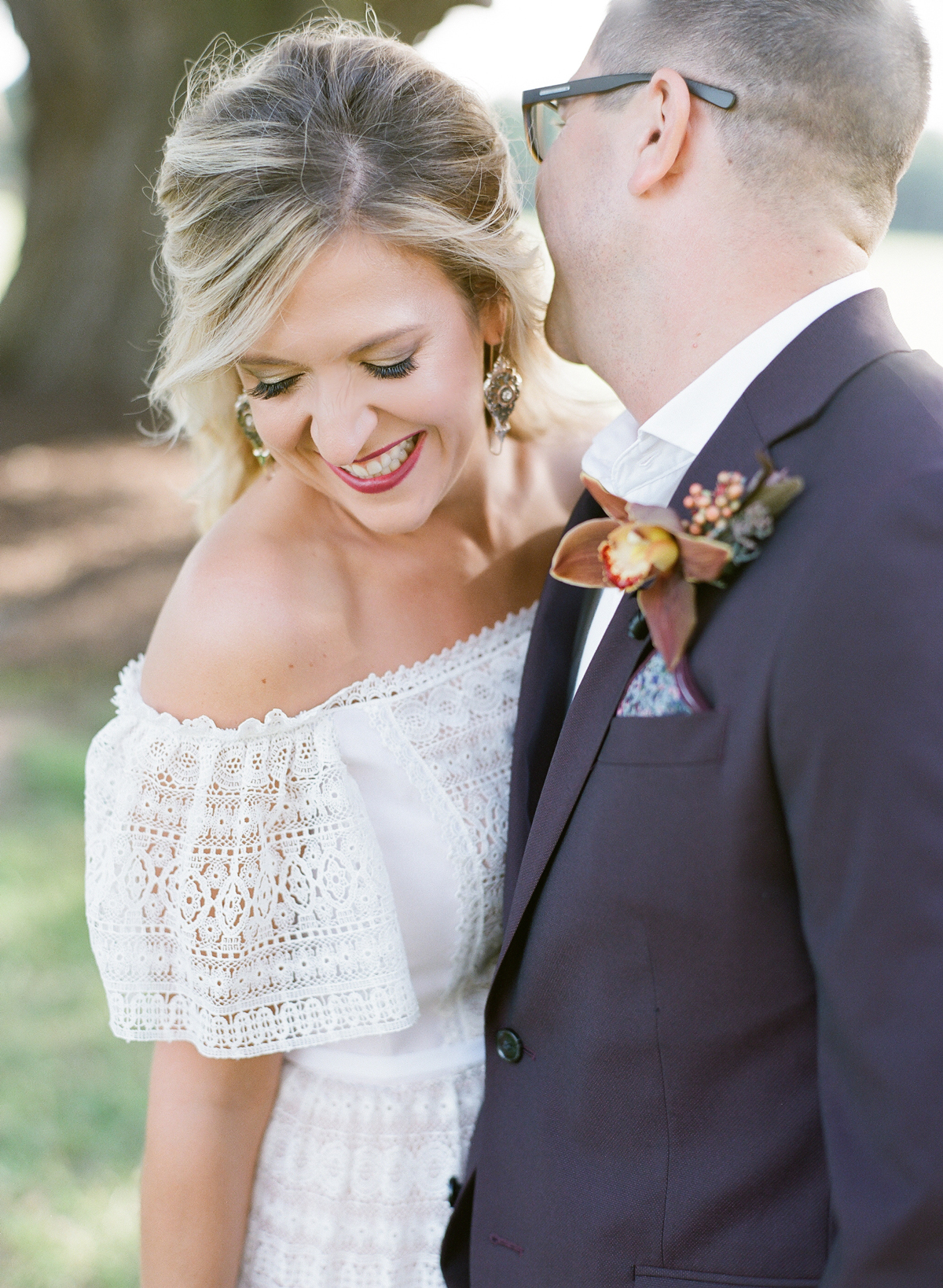 Couple poses smiling for vow renewal