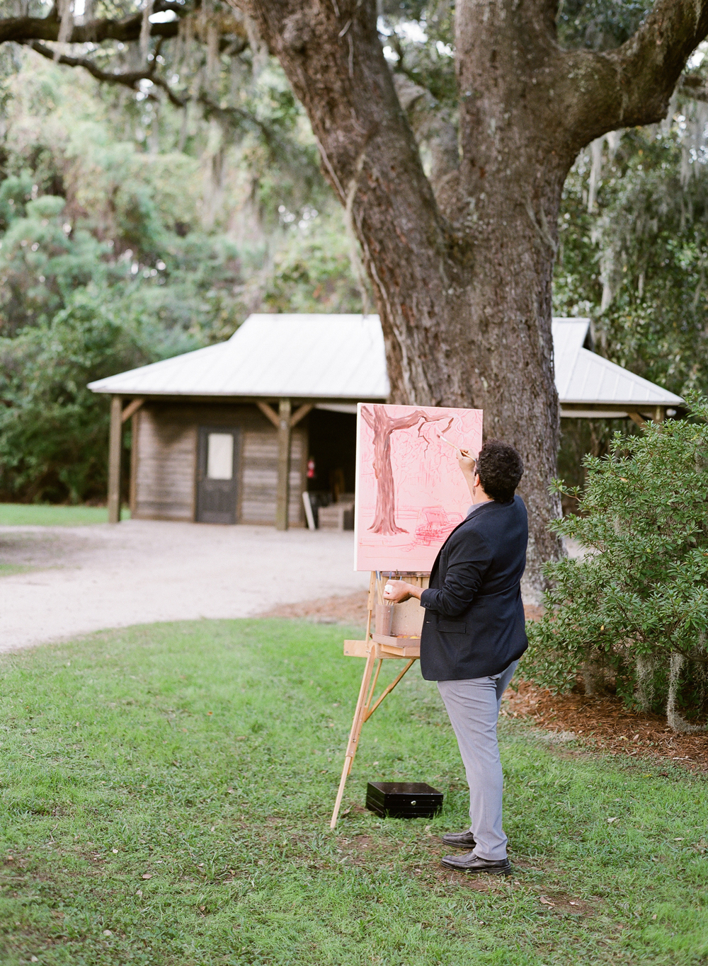 Man live painting outdoors